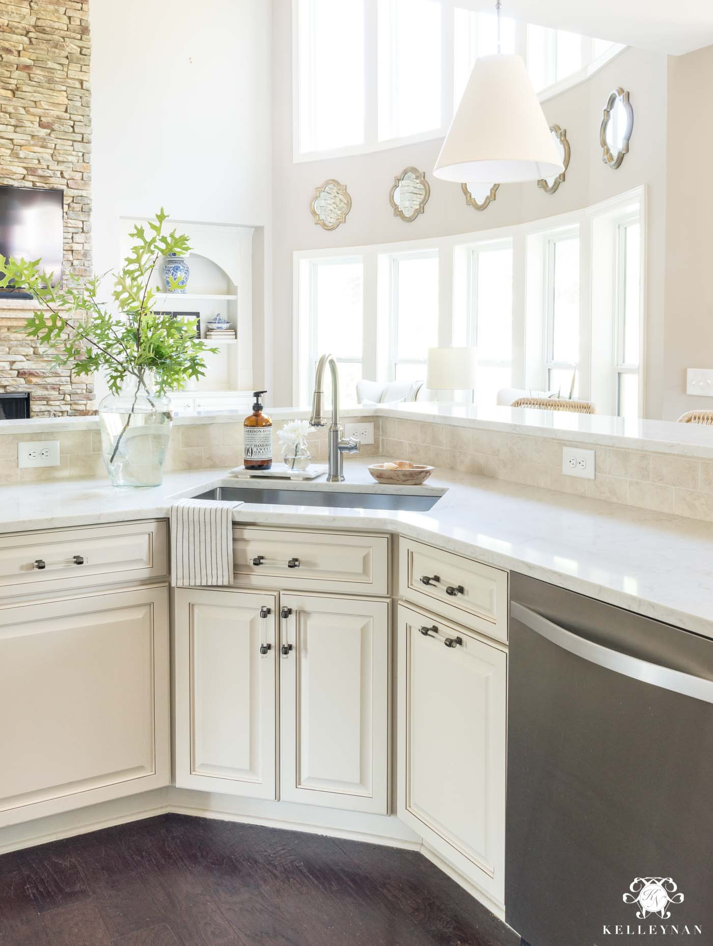 Updating an out-dated cream kitchen with white quartz countertops