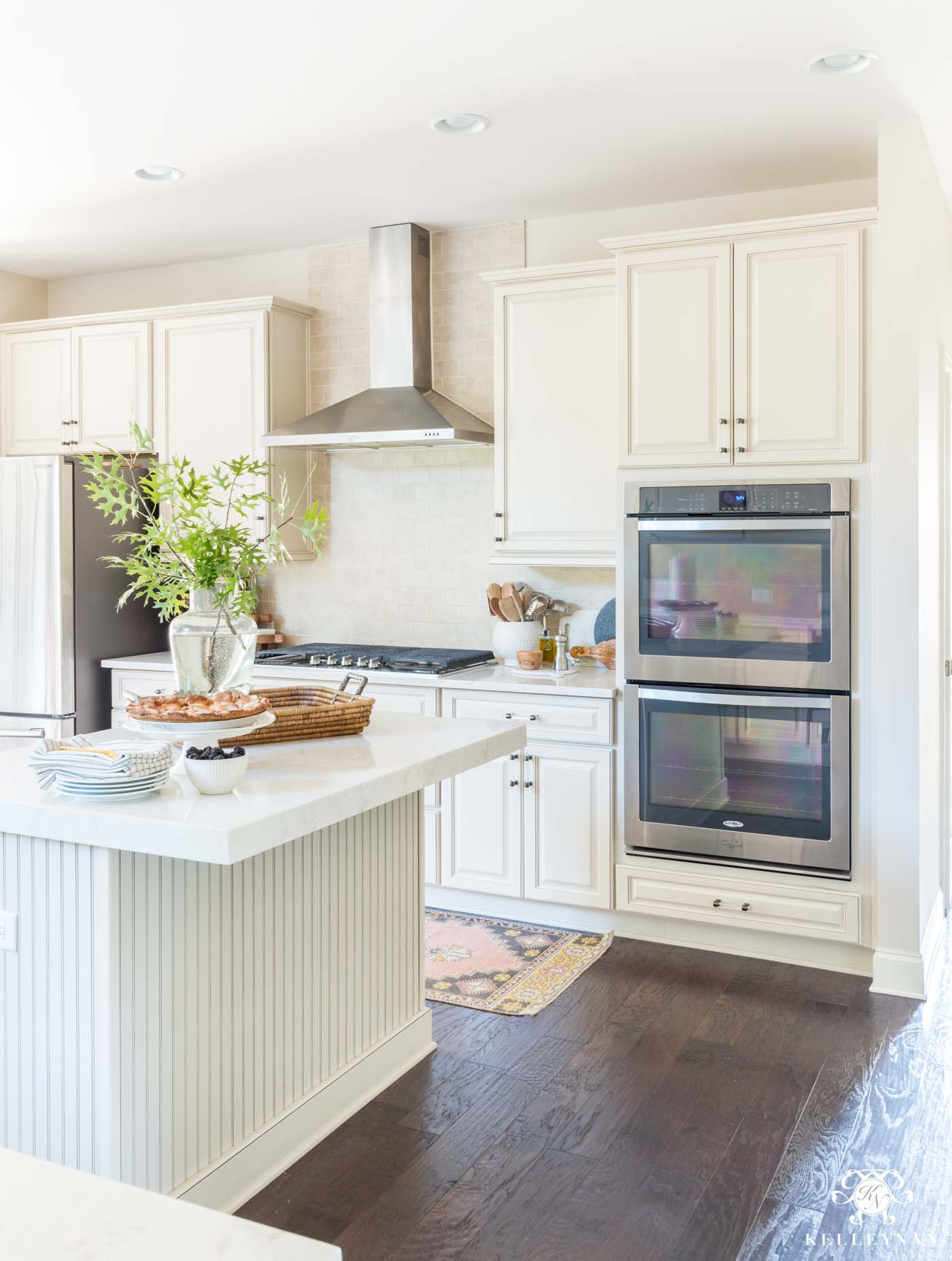 How to update a cream kitchen with raised panel cabinets
