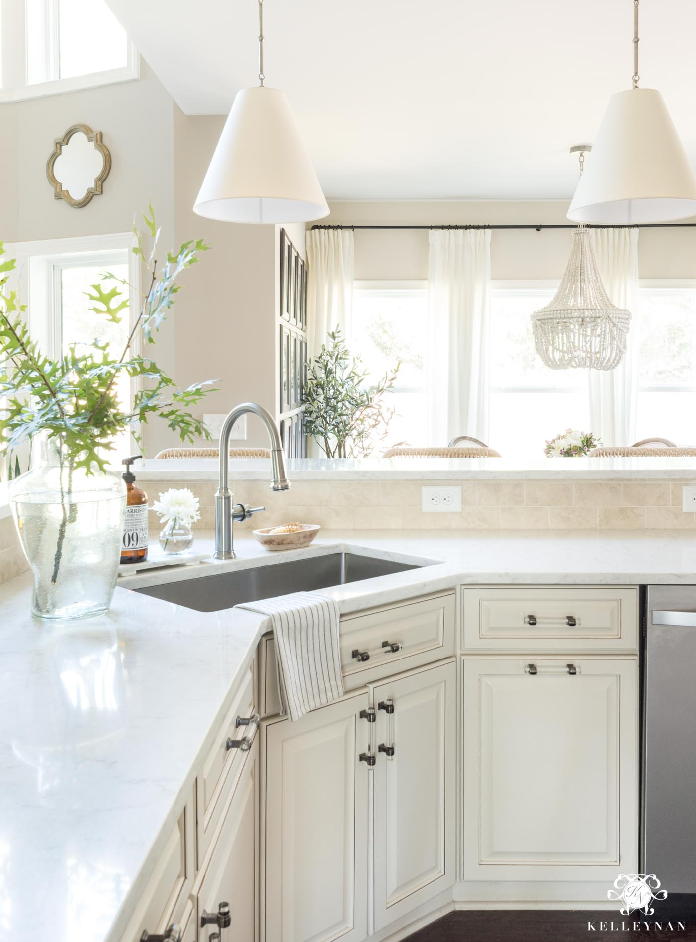 Cream kitchen cabinets with updated fixtures and more modern finishes