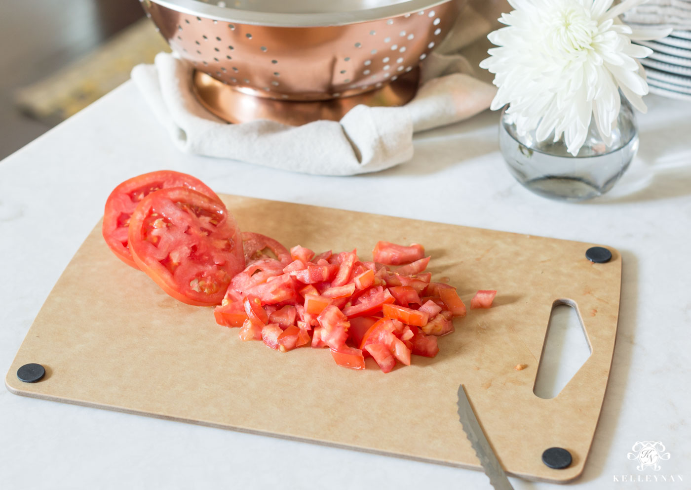 Chopping tomatoes on cutting board