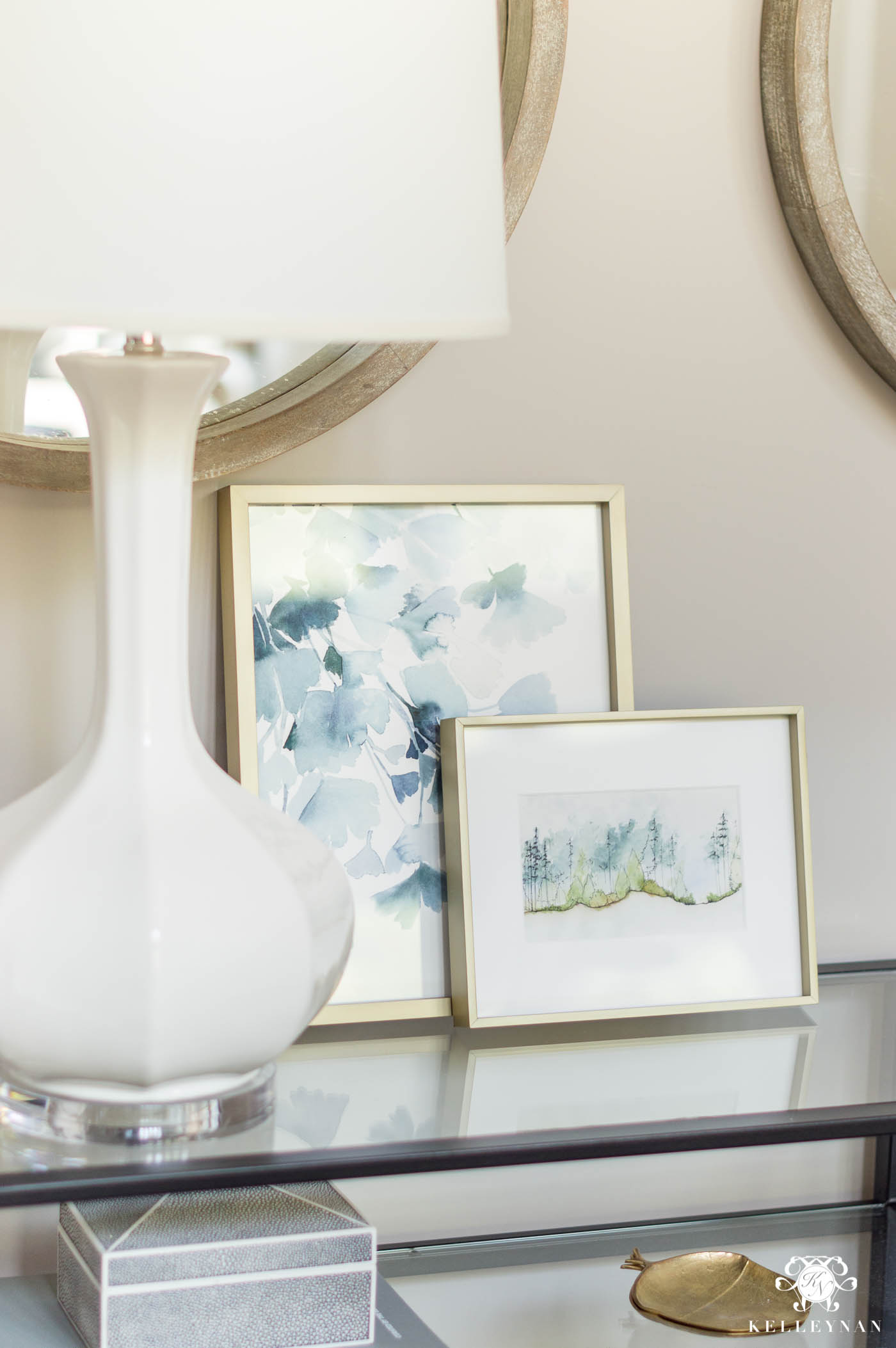 Layered art on console table