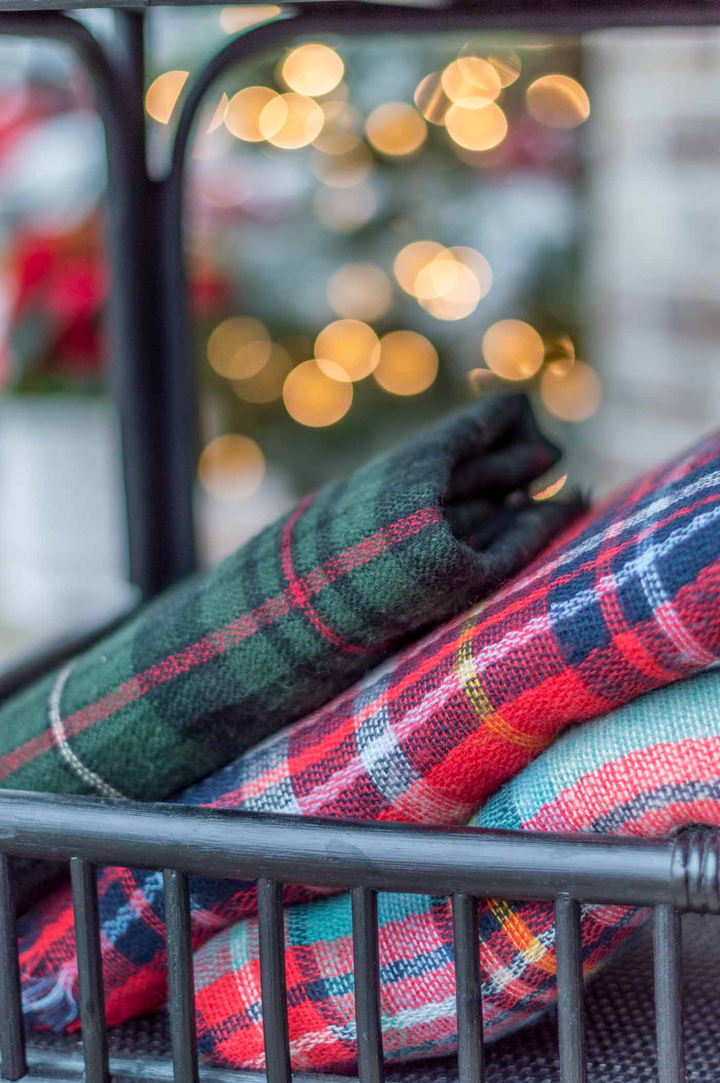 Cozy Christmas Porch Decor with Tartan and Plaid Blankets