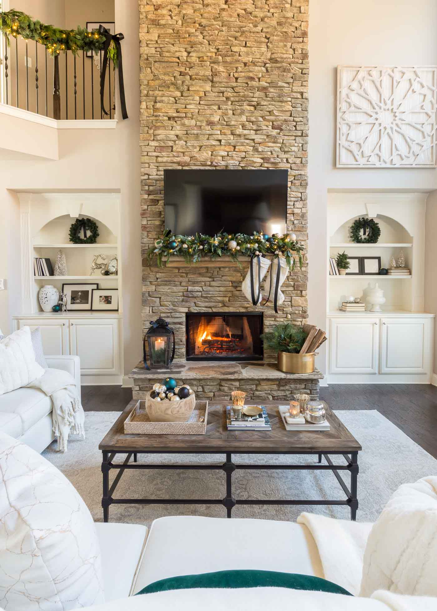 Christmas living room decor and decorated fireplace mantel