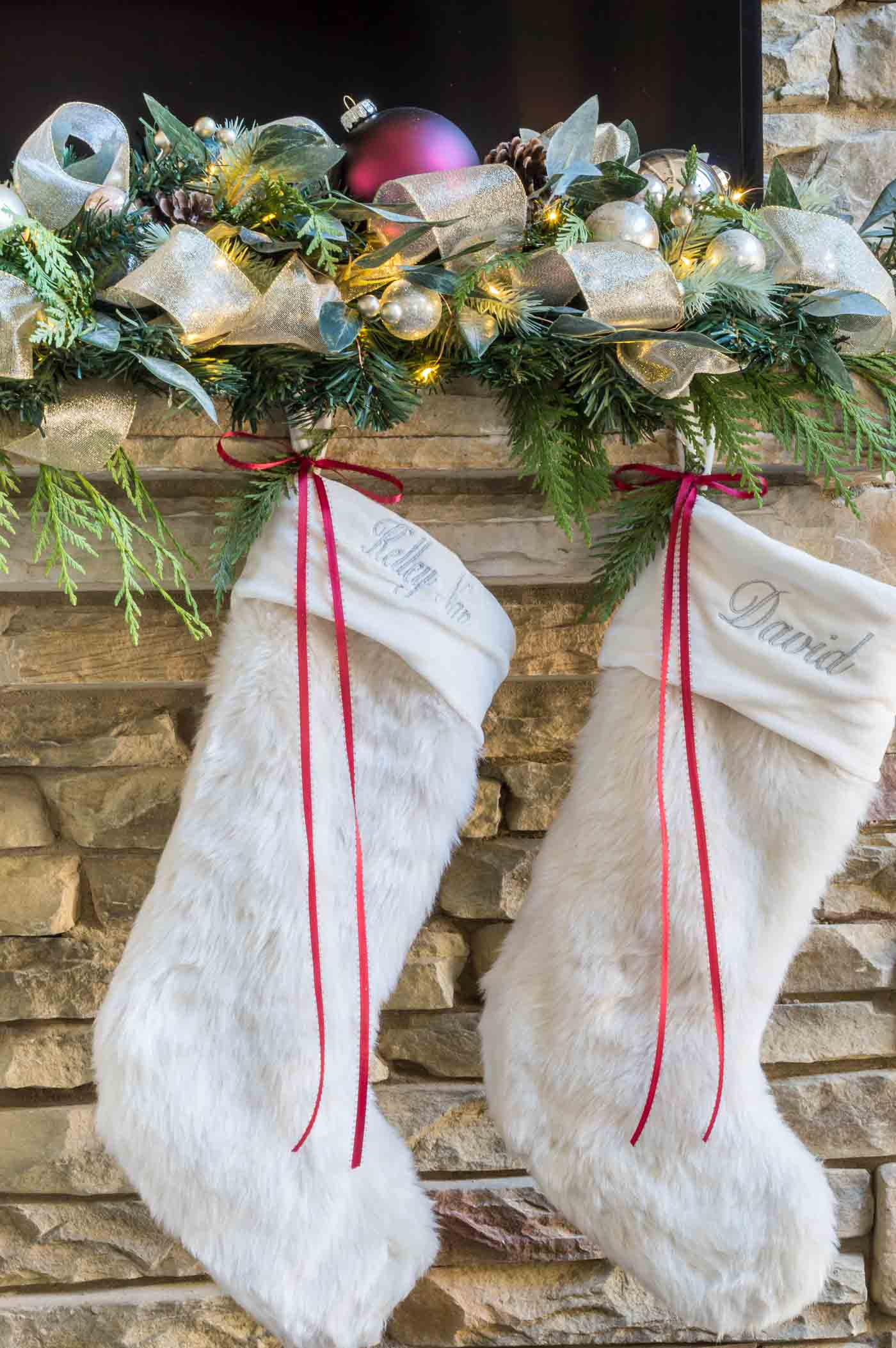 Christmas fireplace ideas with stocking hung with ribbon and garland