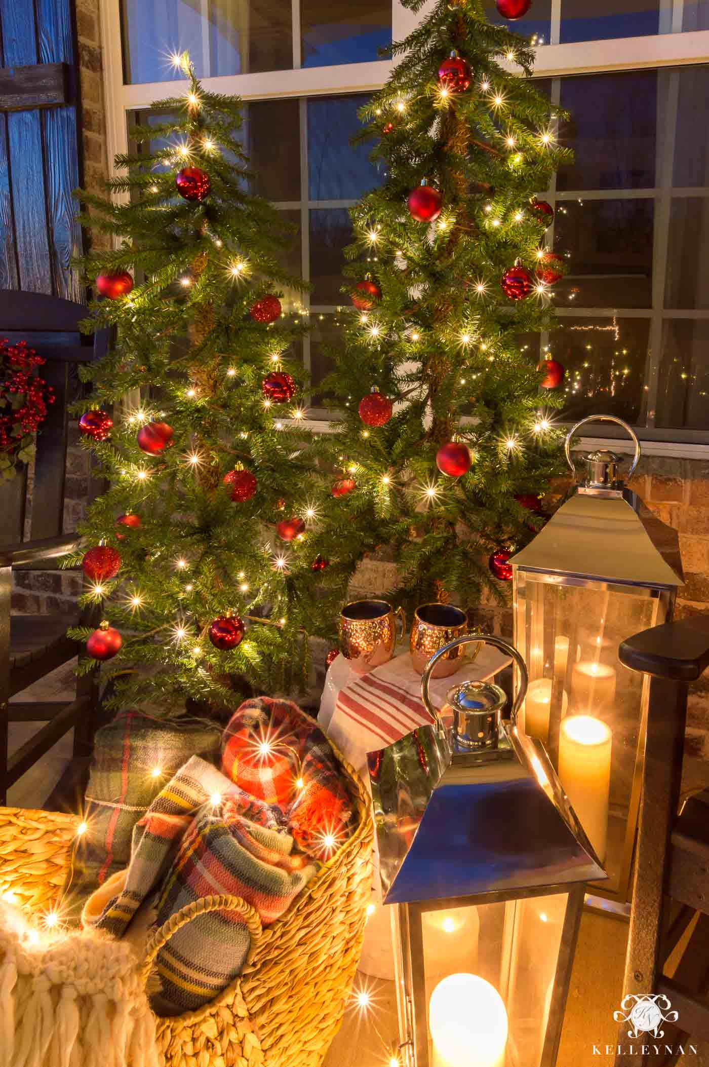 Traditional Christmas decorations on the front porch with cozy lanterns and throw blankets