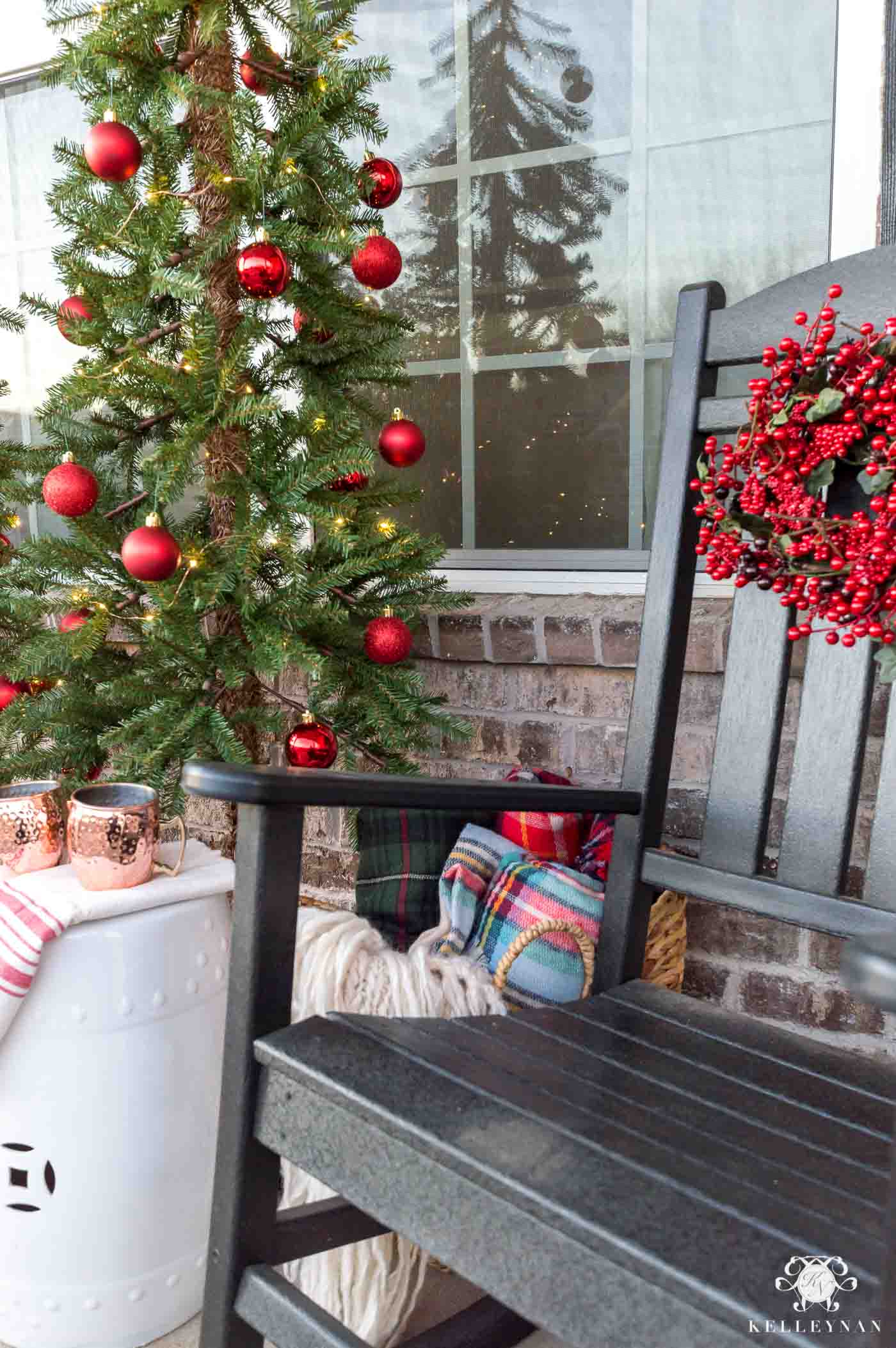 Rocking chair Christmas decorations with red berry wreaths