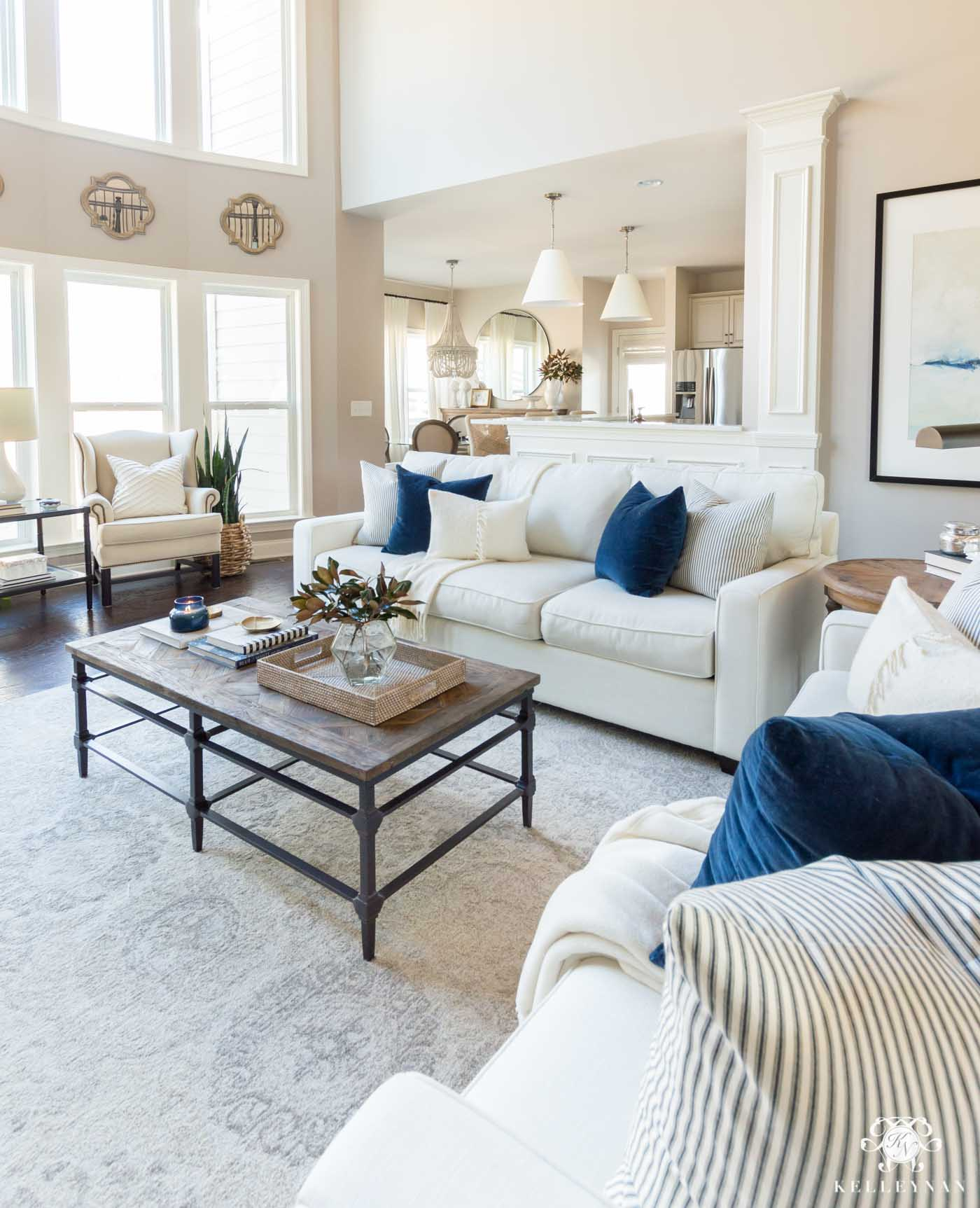 Open concept living room with blue and white decor