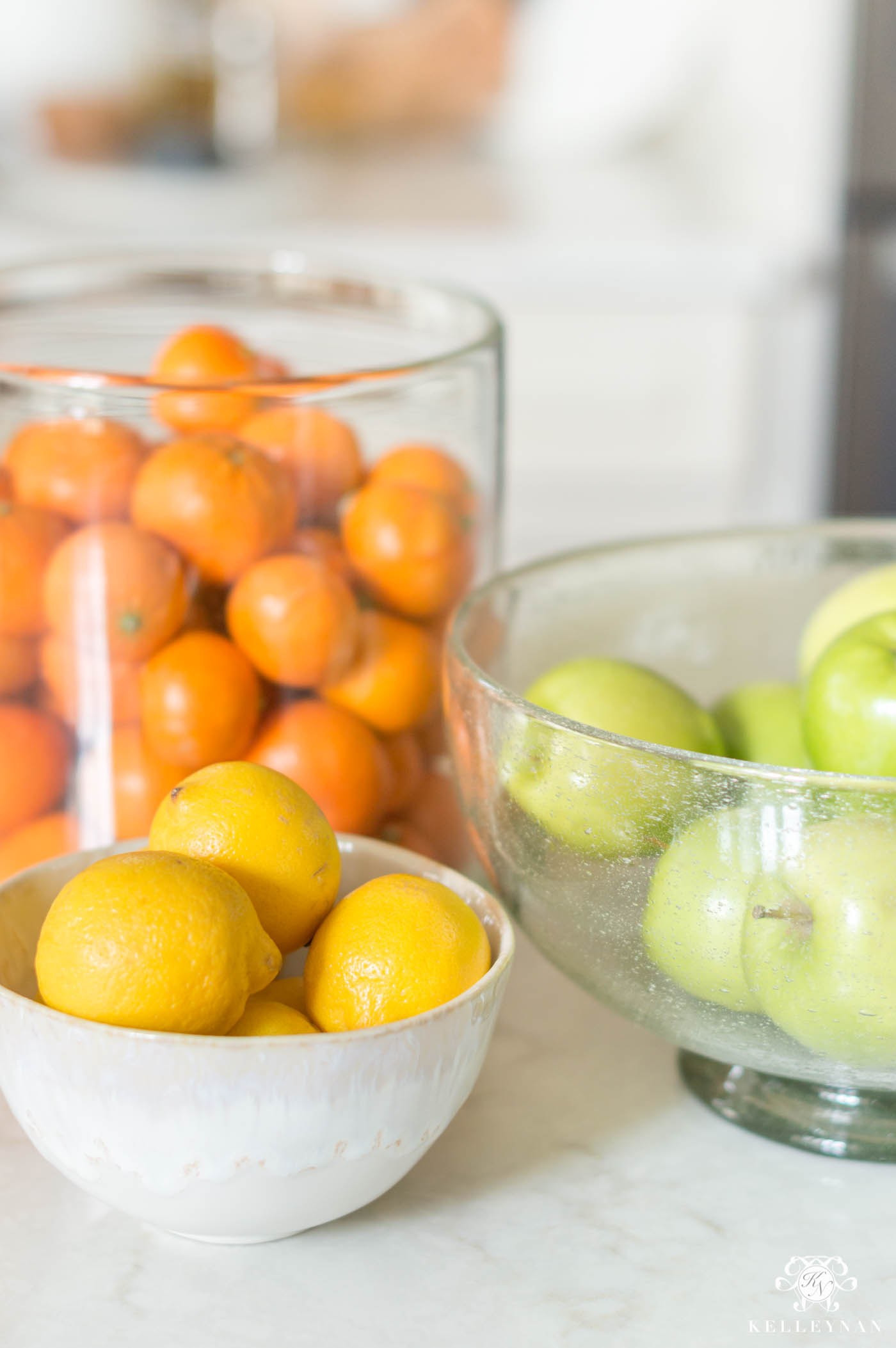 Spring kitchen decorating ideas with citrus fruit, lemons, oranges, and apples