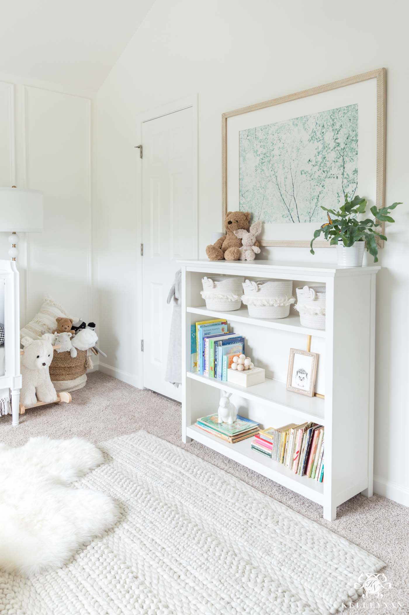 Baby room styled bookshelf and decor