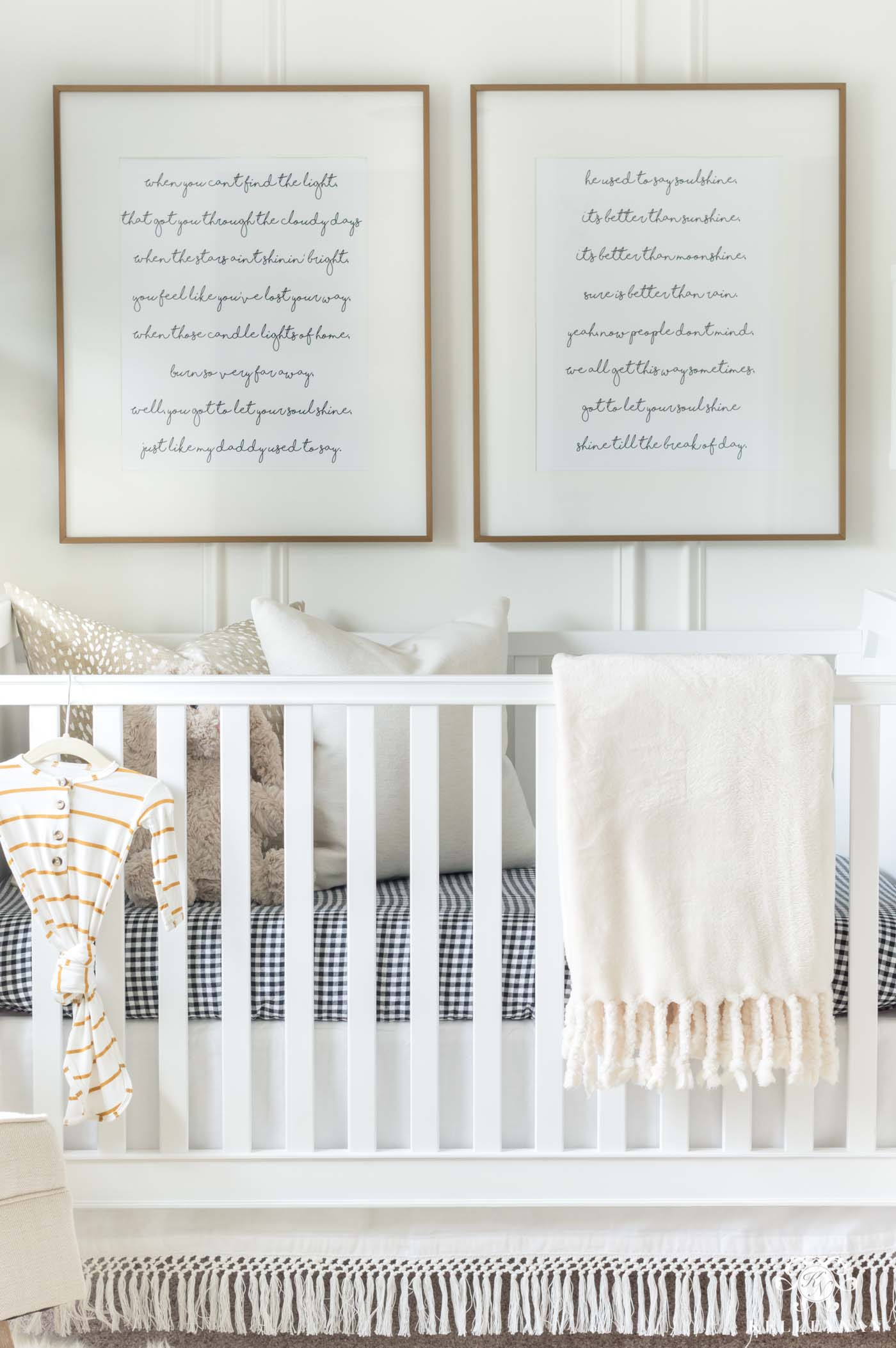 Framed song lyrics above the nursery crib