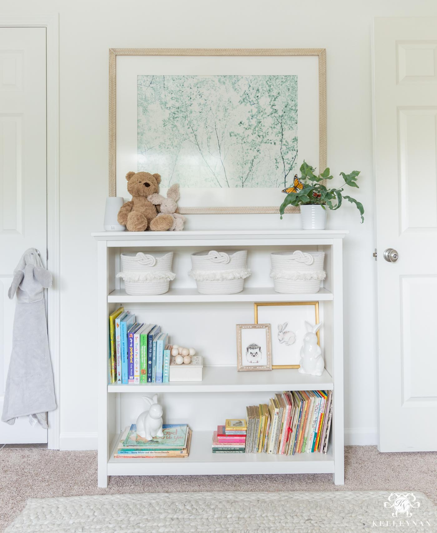 Gender neutral nursery styled bookcase with books and toys