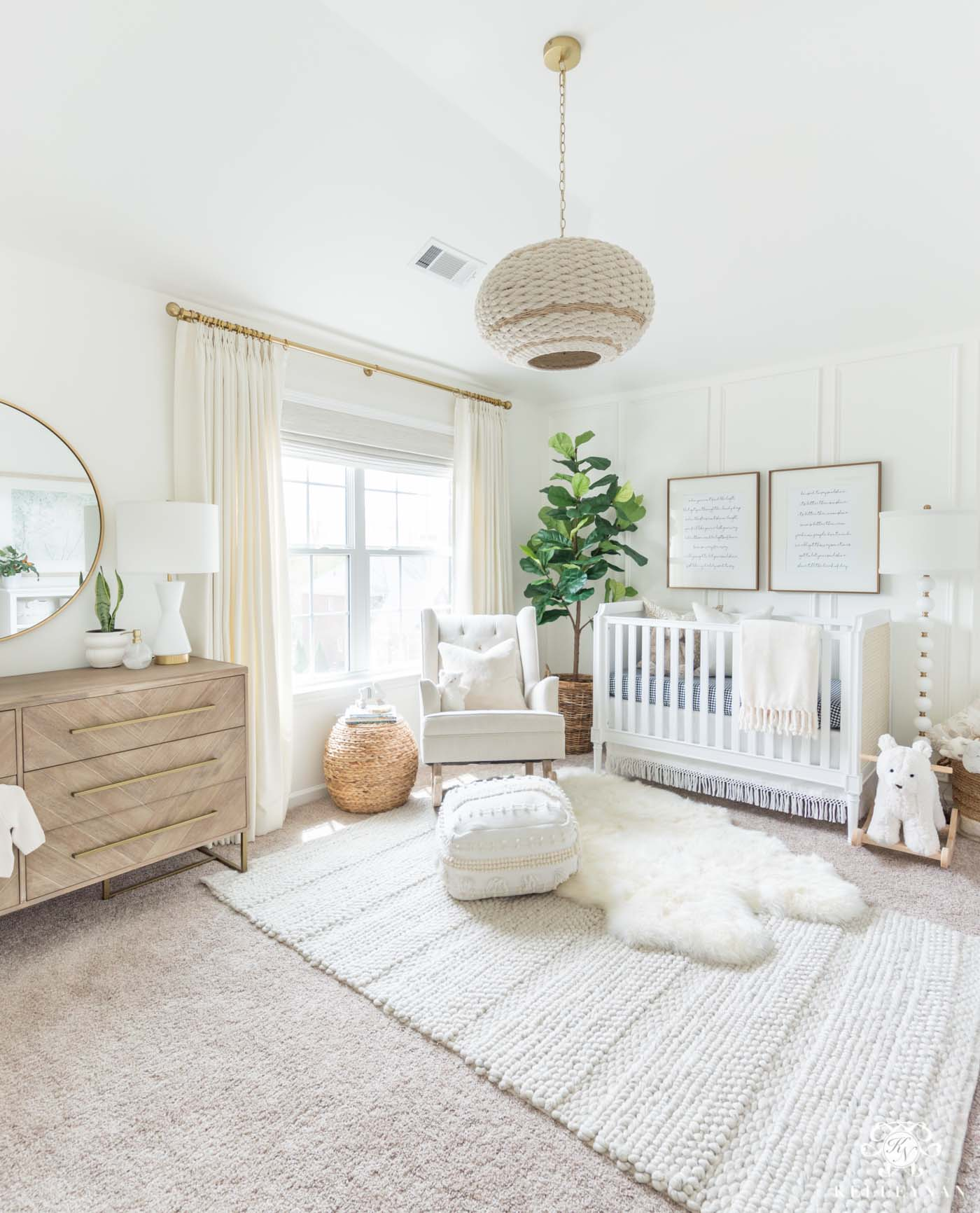 Beautiful gender neutral nursery design with white walls and woodland decor - soft, modern, and a little bohemian