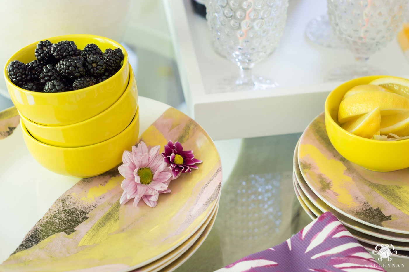 Drew Barrymore Flower Line Favorites with yellow and purple flower scheme