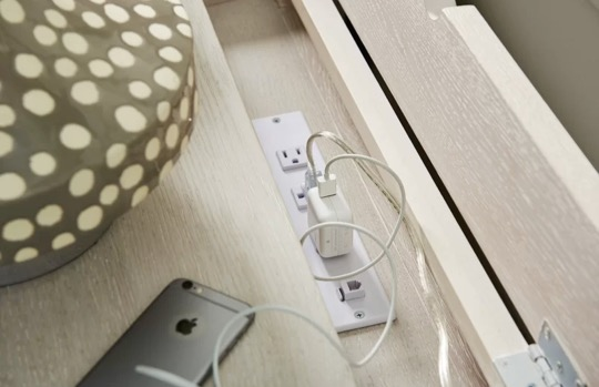 Nightstand with hidden outlets for a bedside charging station
