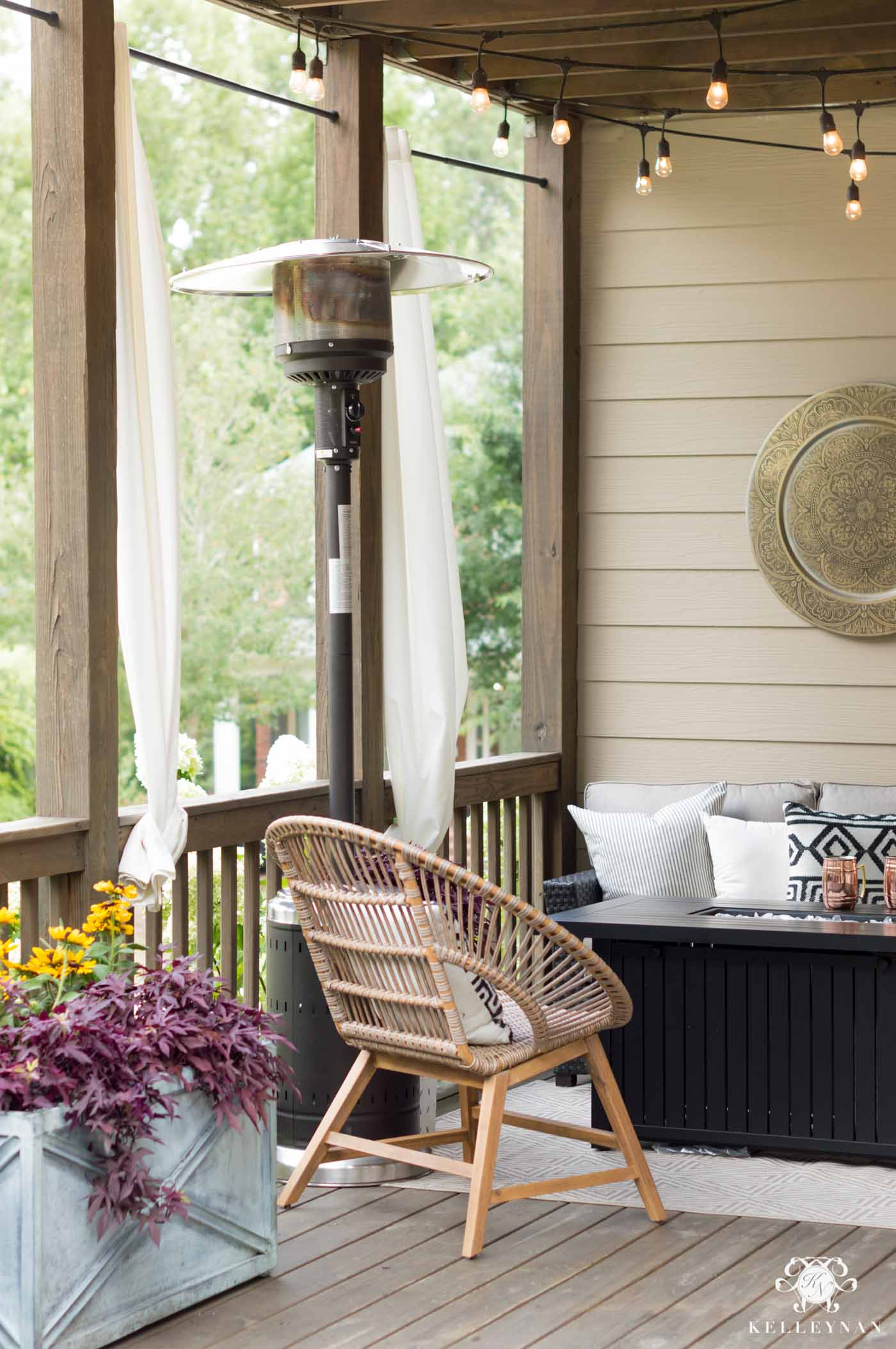 Fall porch necessities with a fire pit and heat lamp