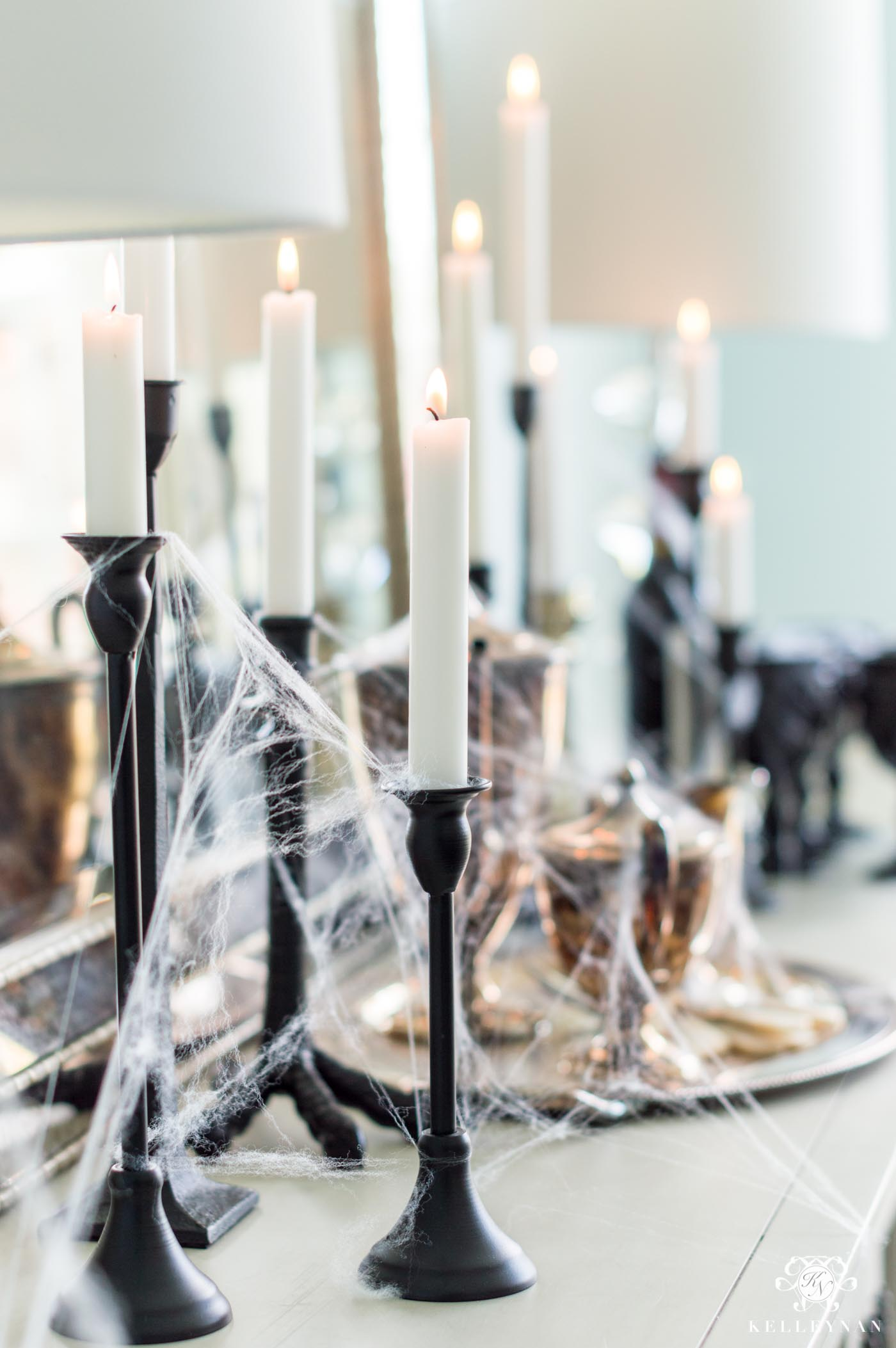 Spooky Halloween Decor Ideas with Candles and Cobwebs