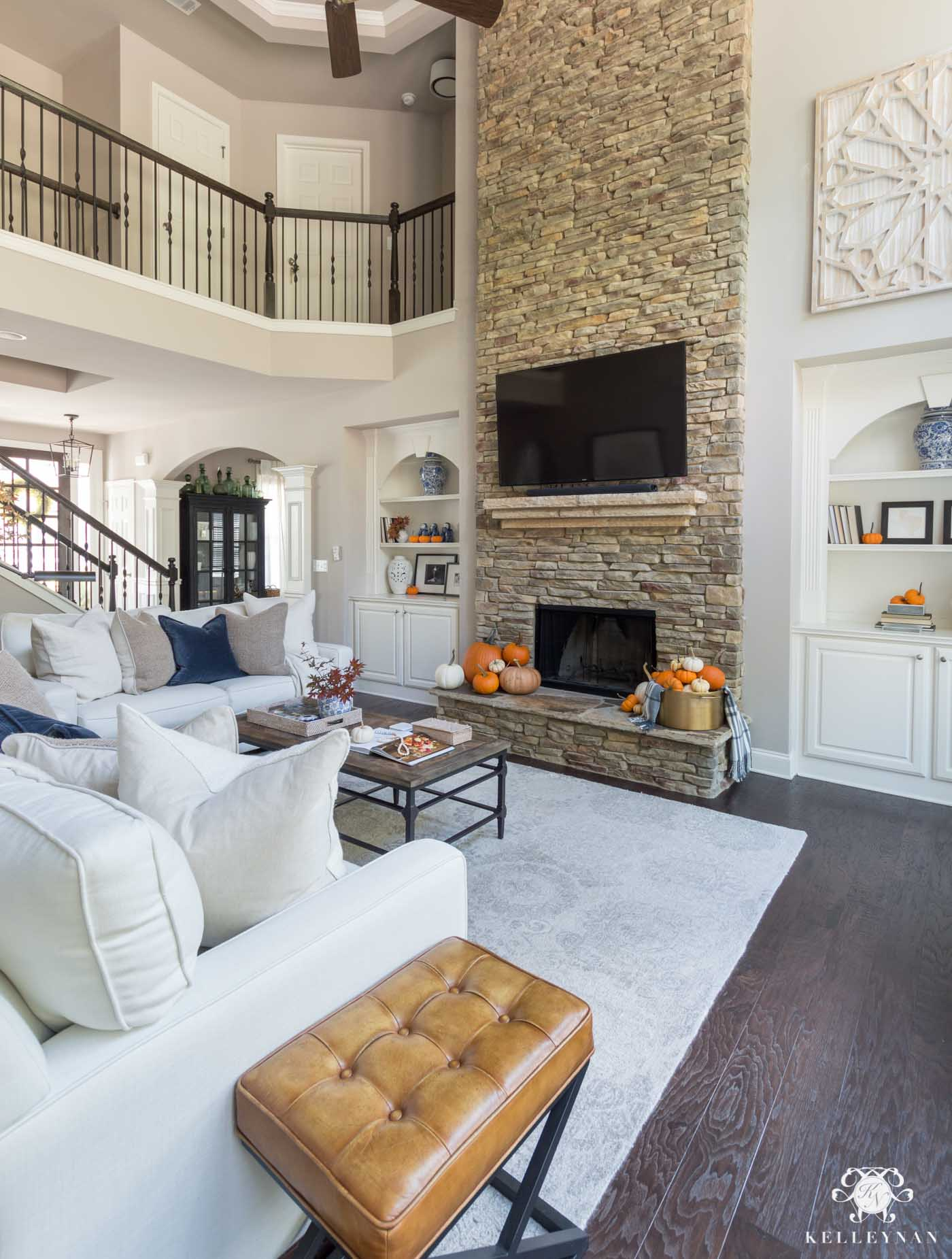 Fall living room decor and stone fireplace inspo