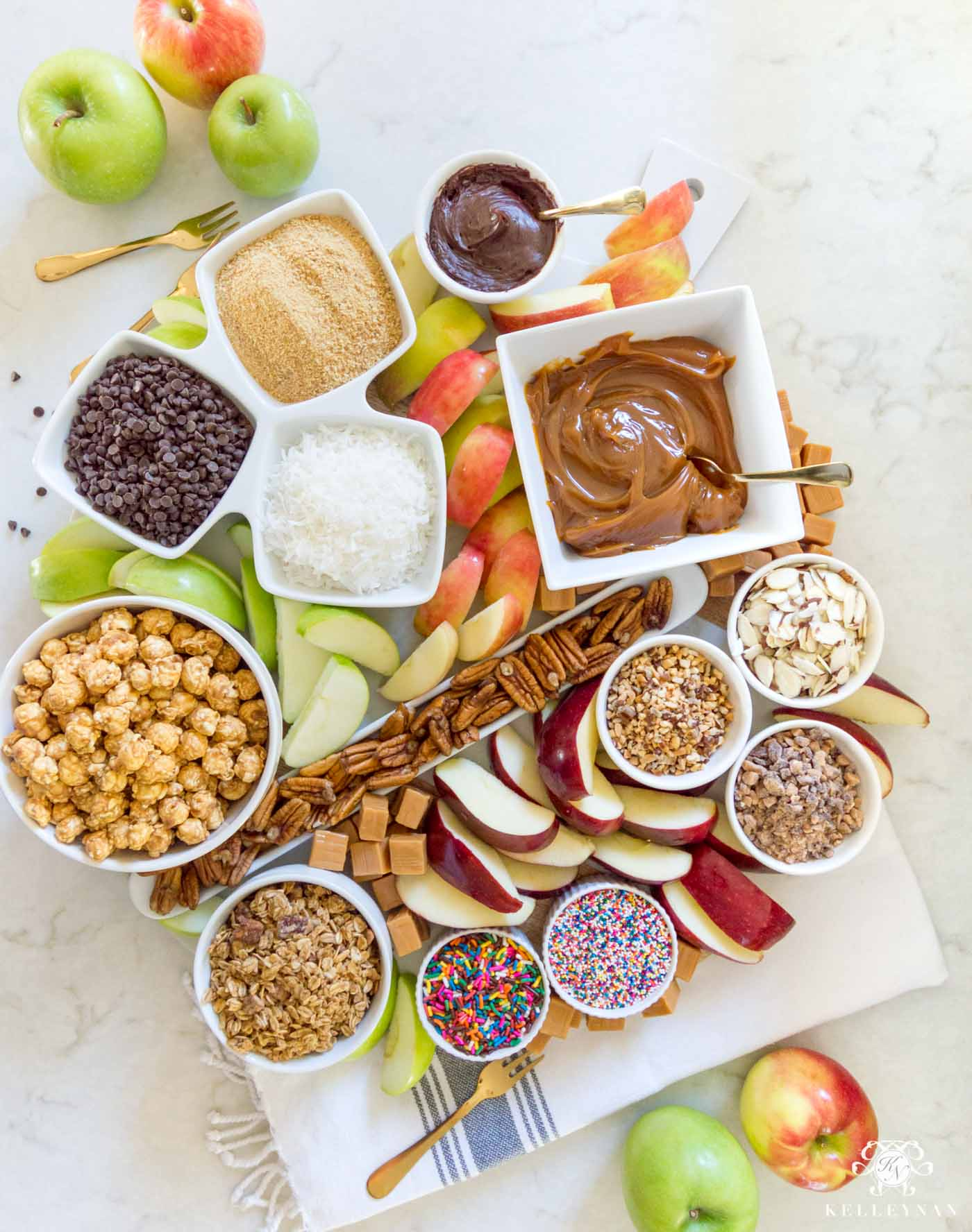 The perfect fall appetizer idea: a caramel apple board with all the toppings!