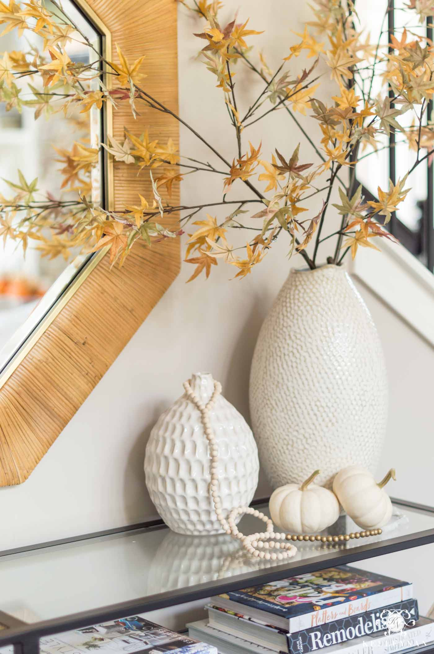 Fall home decor with leaves and pumpkins