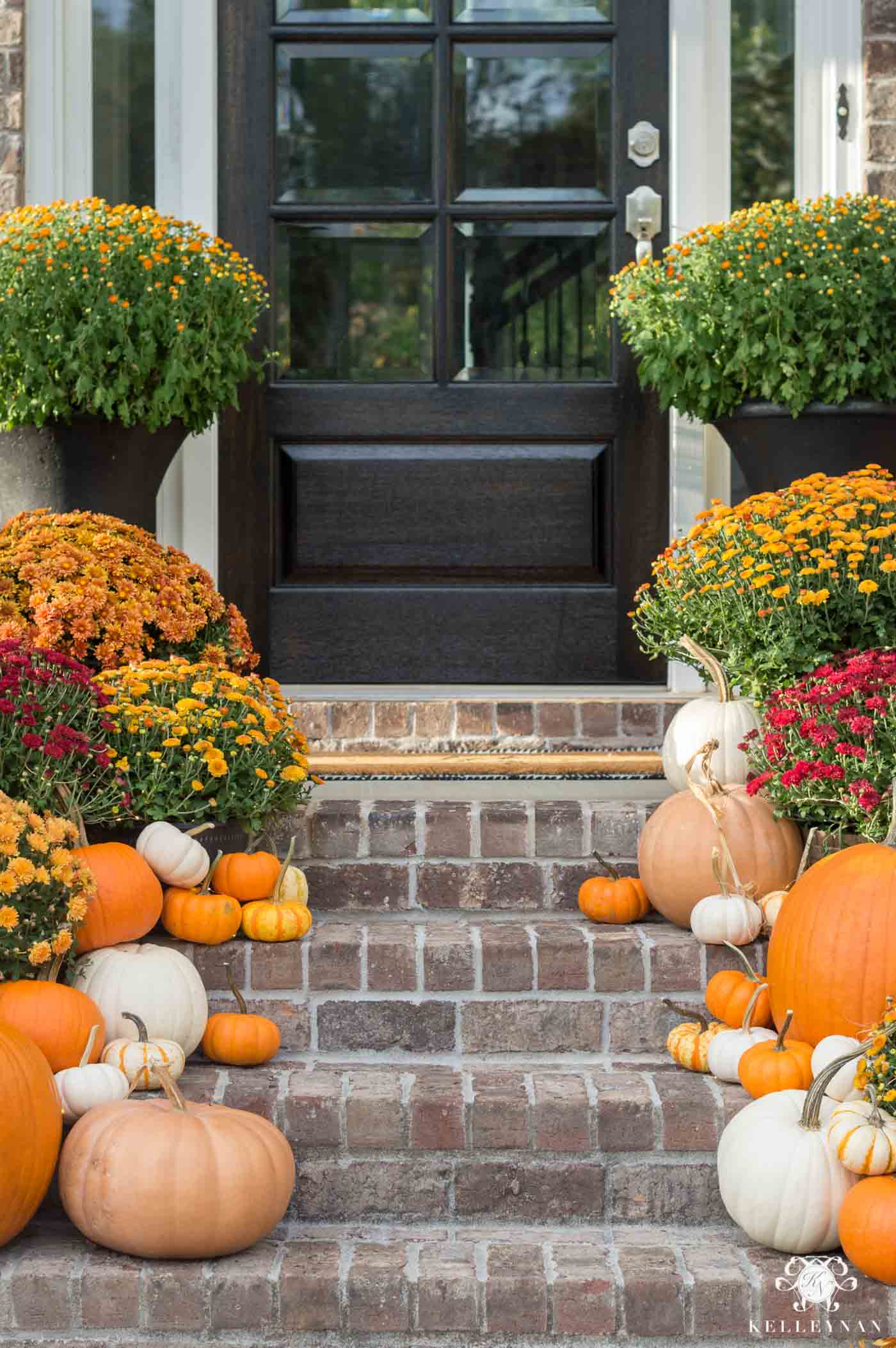Fall porch decor with mums and pumpkins
