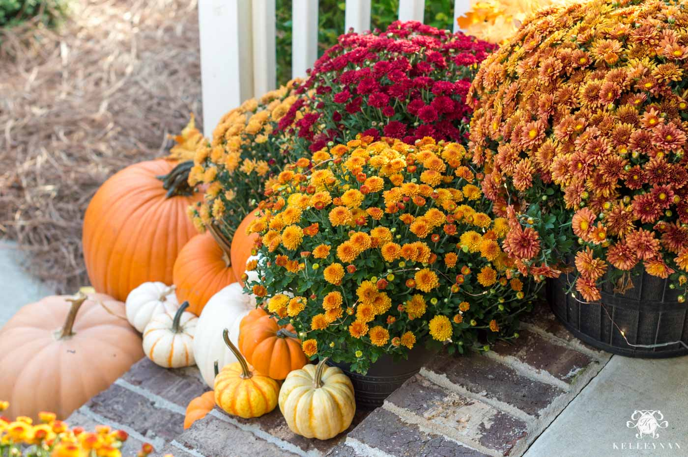 Fall front porch decor with traditional autumn colors