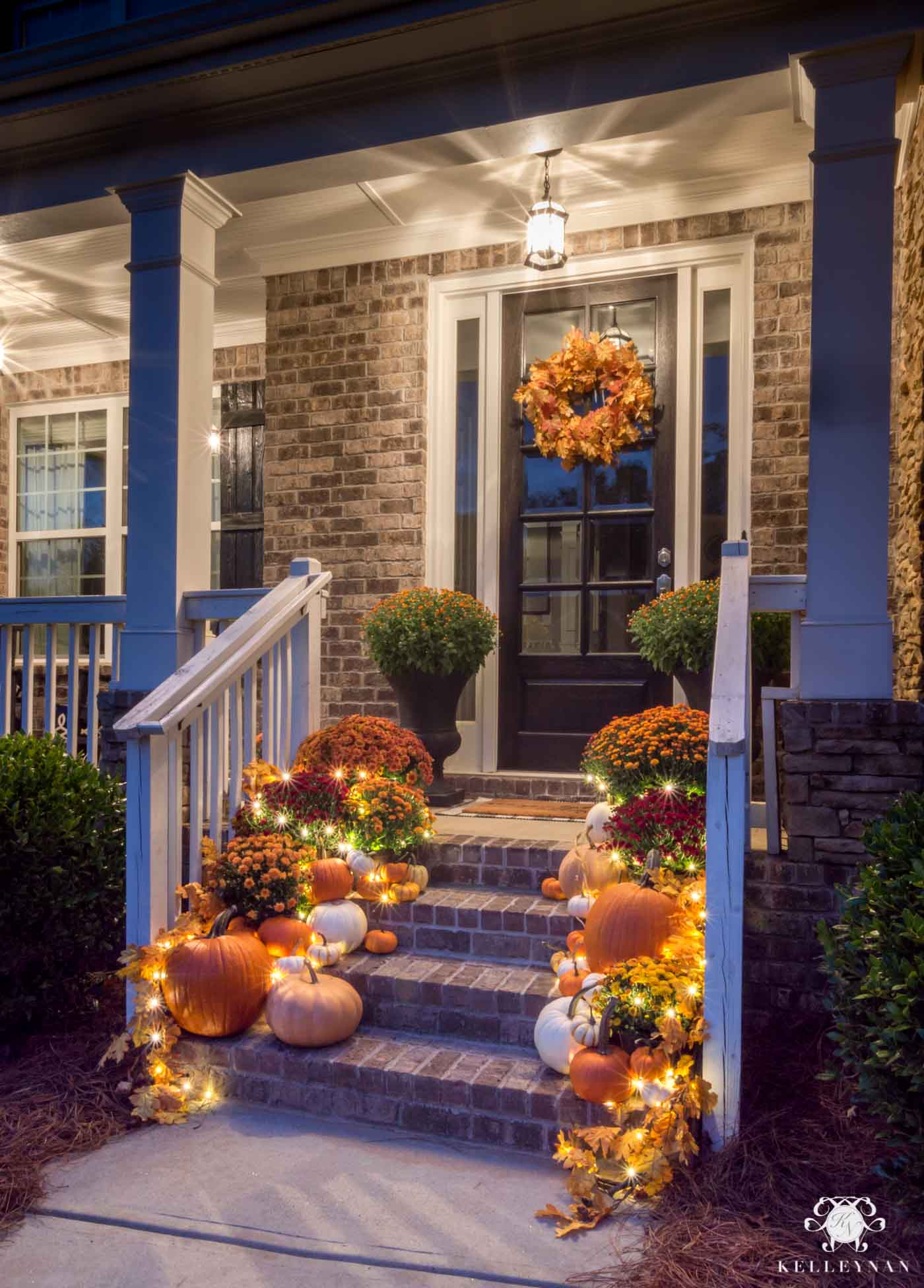 Nighttime fall front porch decor