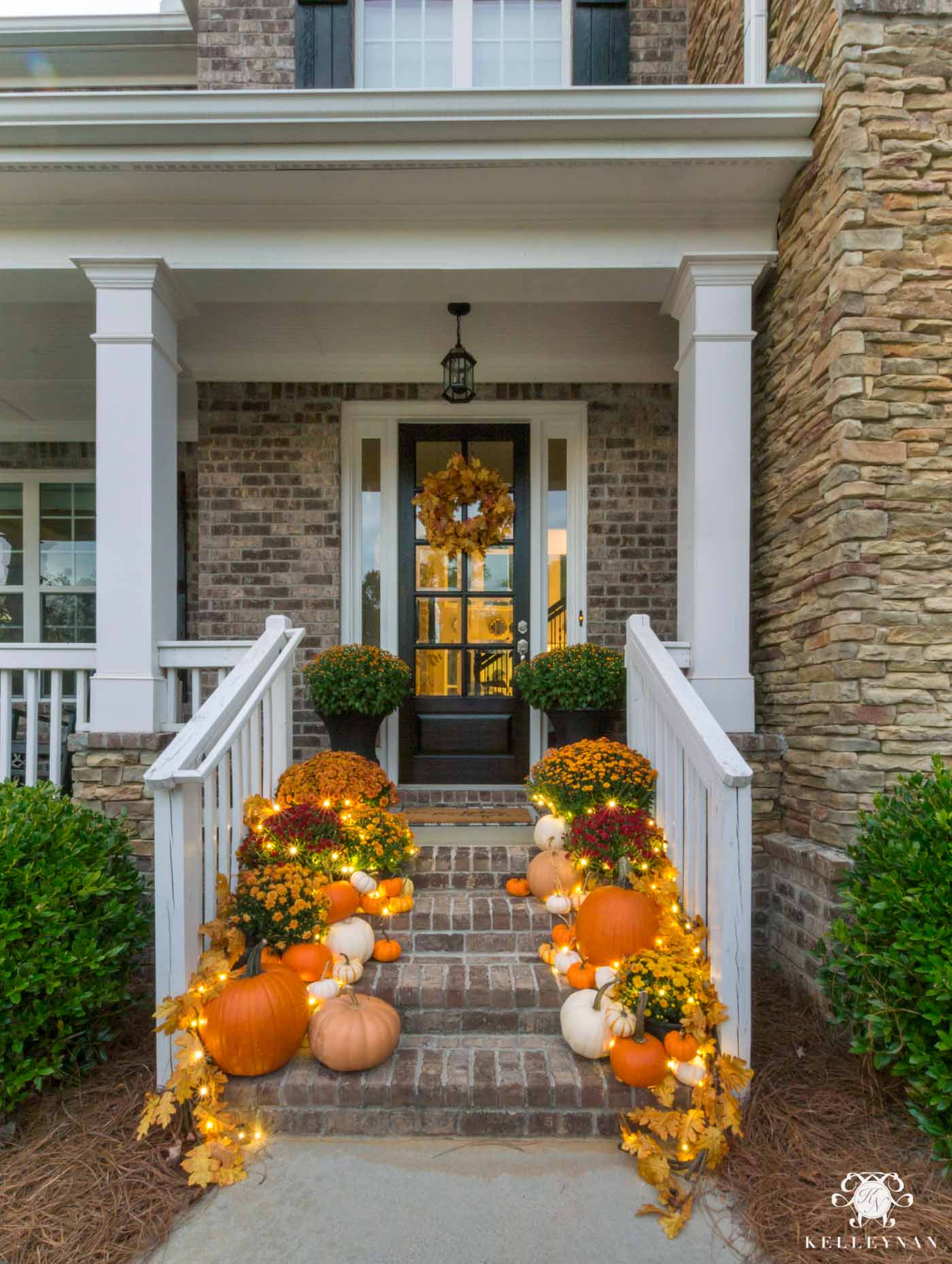 Fall front porch decorating with twinkle lights