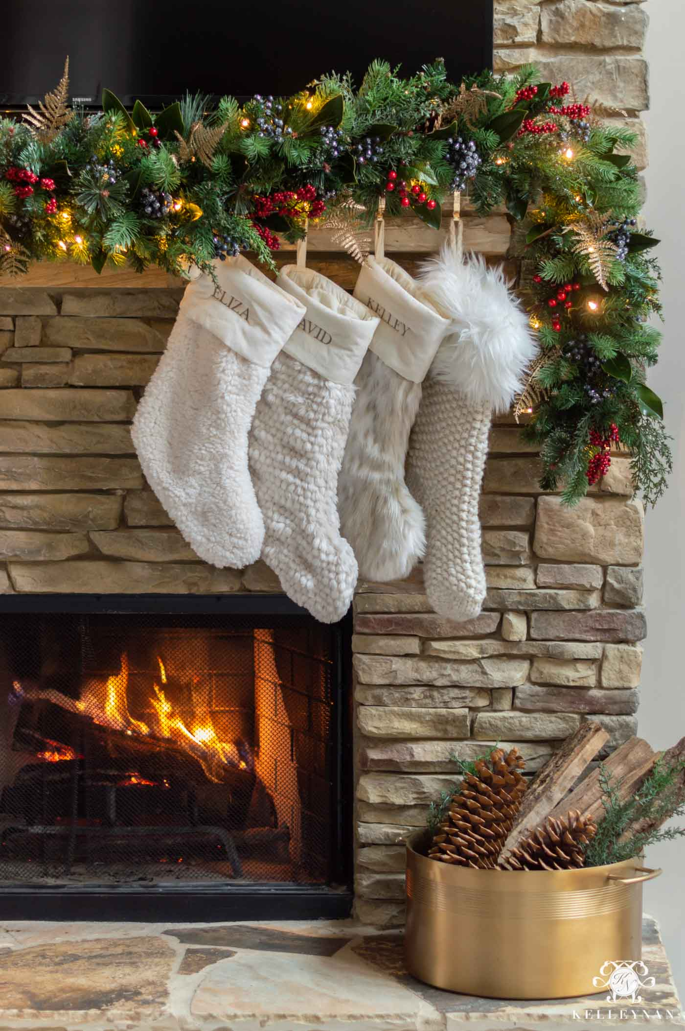 Christmas Fireplace Decor with Greenery and Fur Stockings