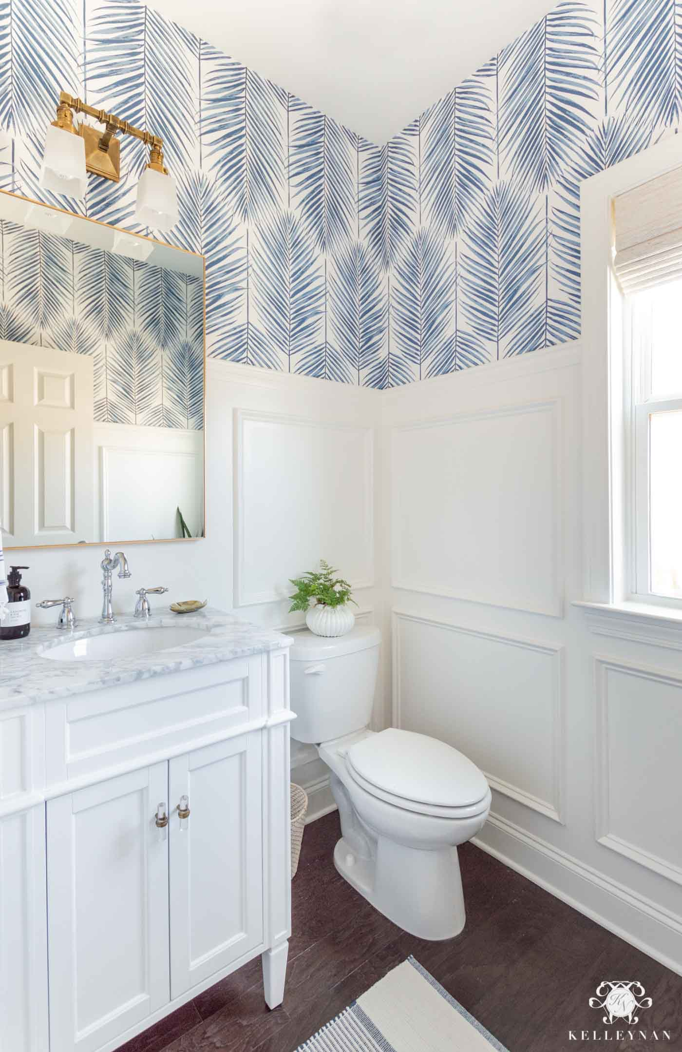 Powder Room Design Ideas in this Makeover Reveal, featuring picture frame moulding and blue palm wallpaper