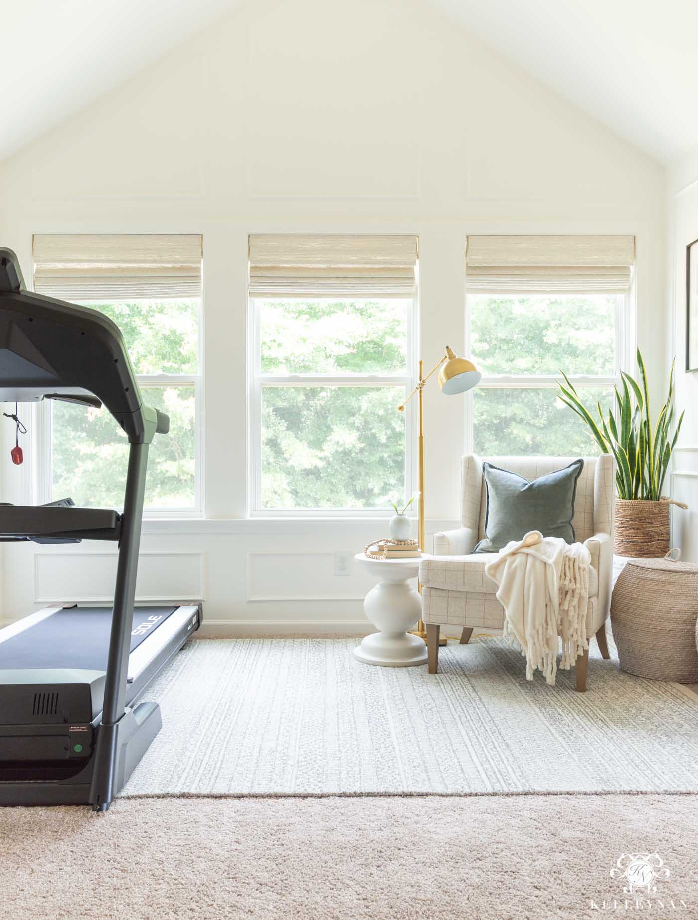 Decorating a Master Bedroom SItting Area with Treadmill Workout Equipment