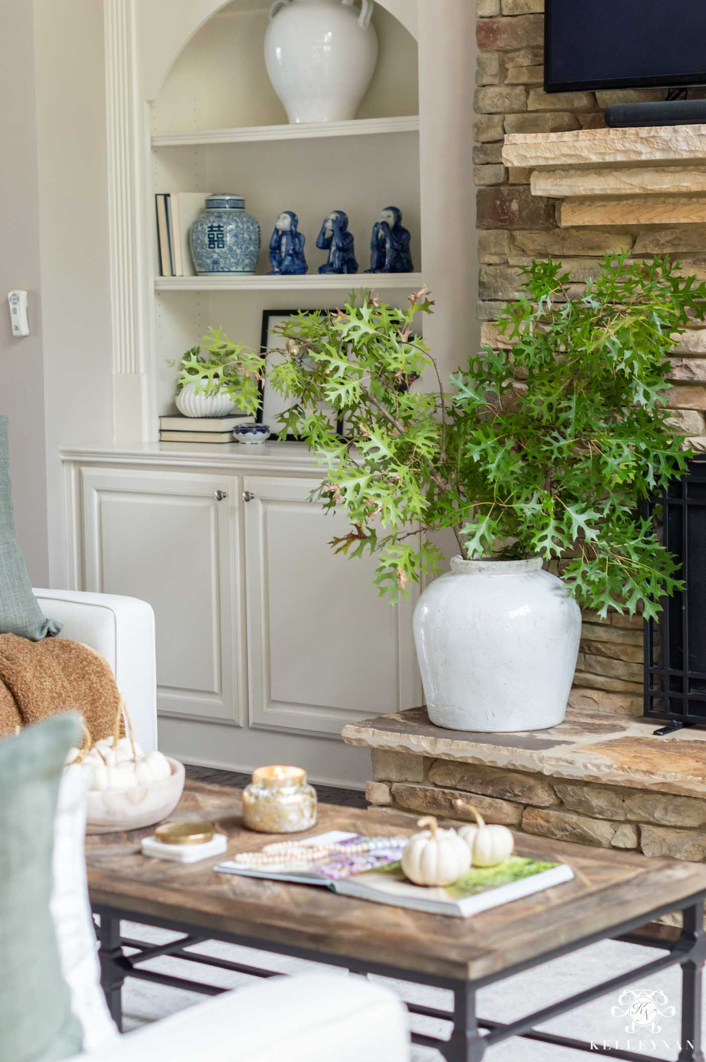 Fall Decorating and Ideas for the Living Room with Green Leaves and White Pumpkins