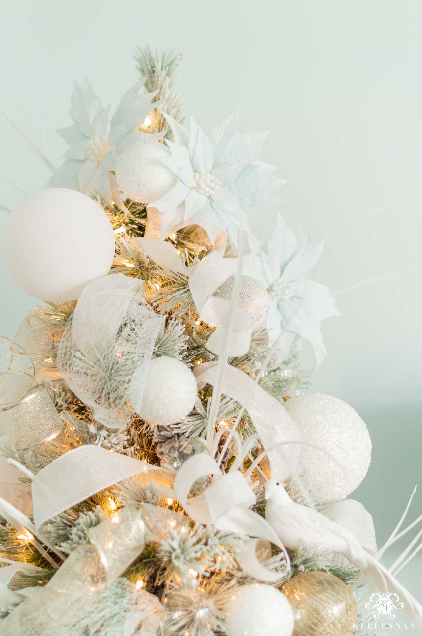Flocked Christmas Tree with Snowy White & Icy Blue Decorations