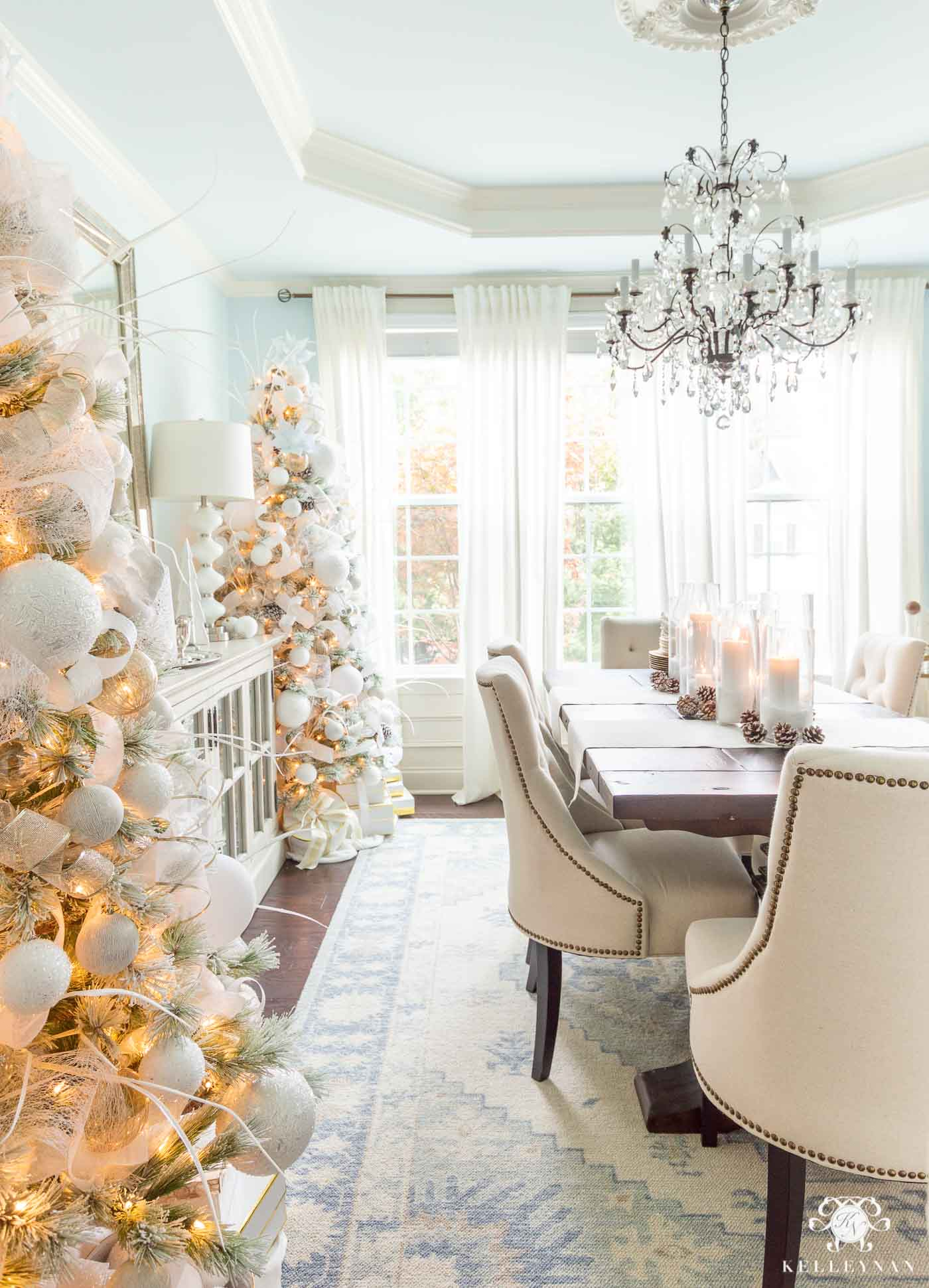 Dining Room Christmas Decor -- Matching Christmas Trees in a Pale Blue Room