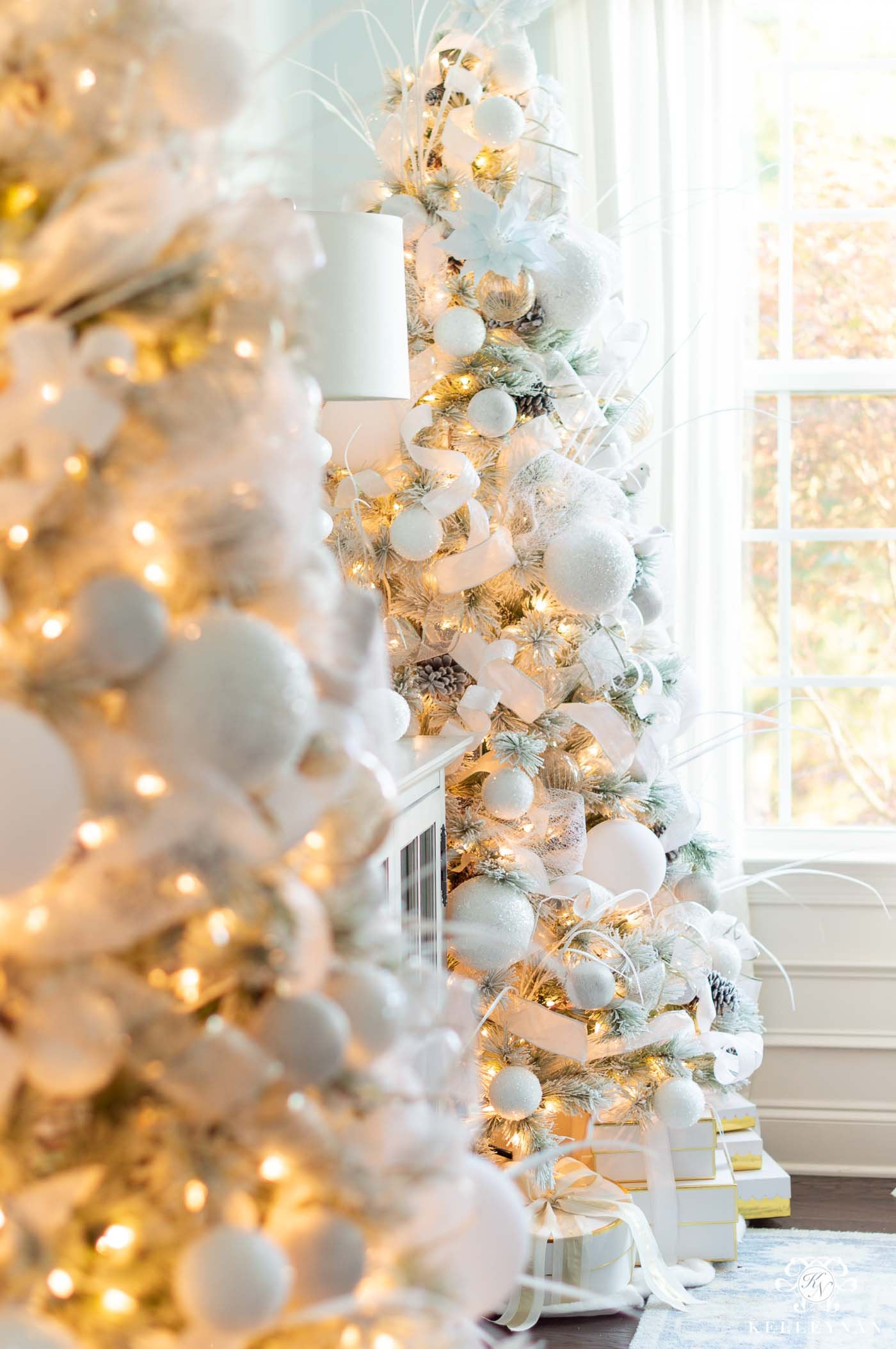 Elegant White Christmas Decor and Snowy Christmas Trees in the Dining Room