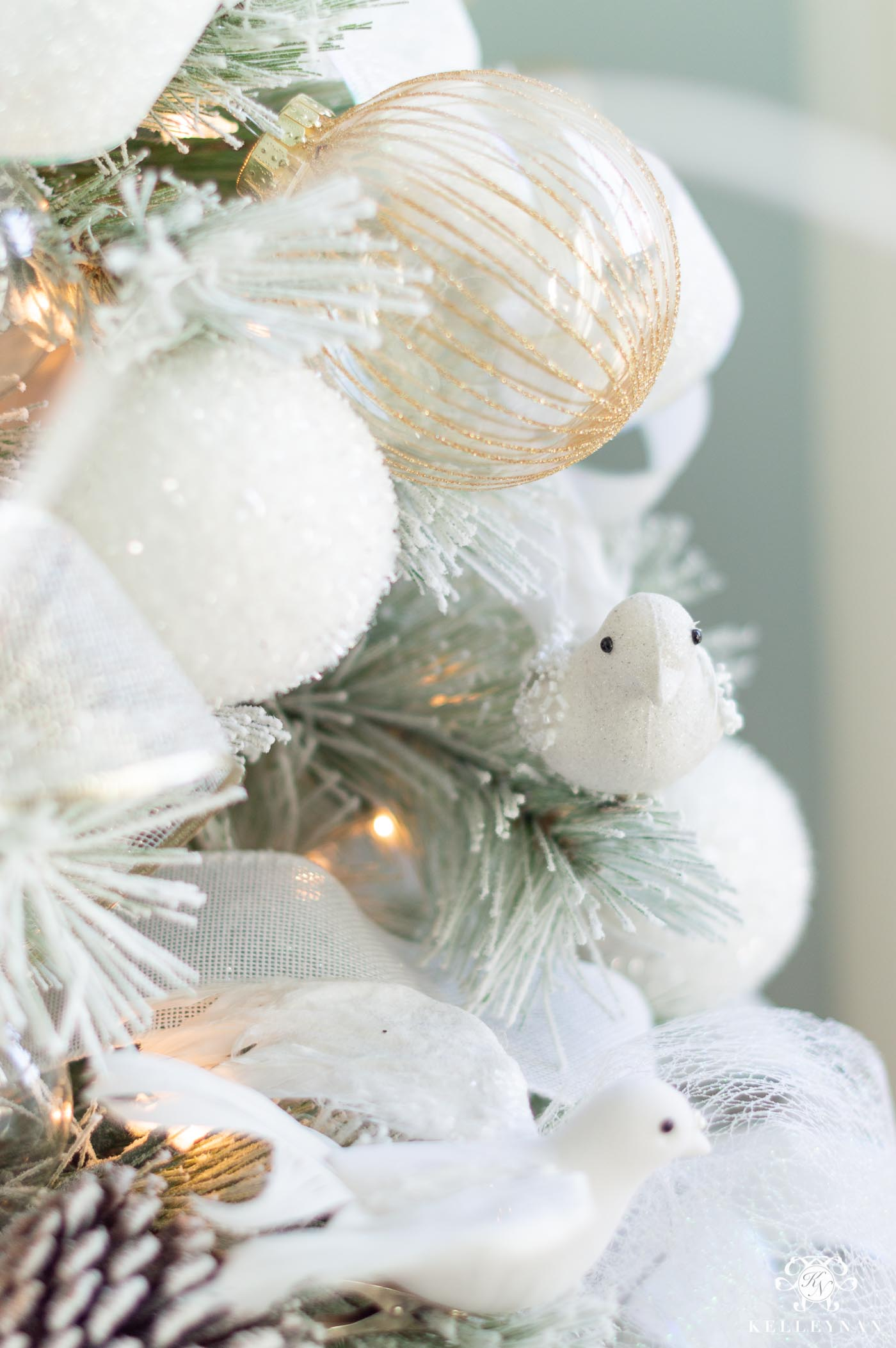 White Flocked Christmas Tree with Pale Blue Accents