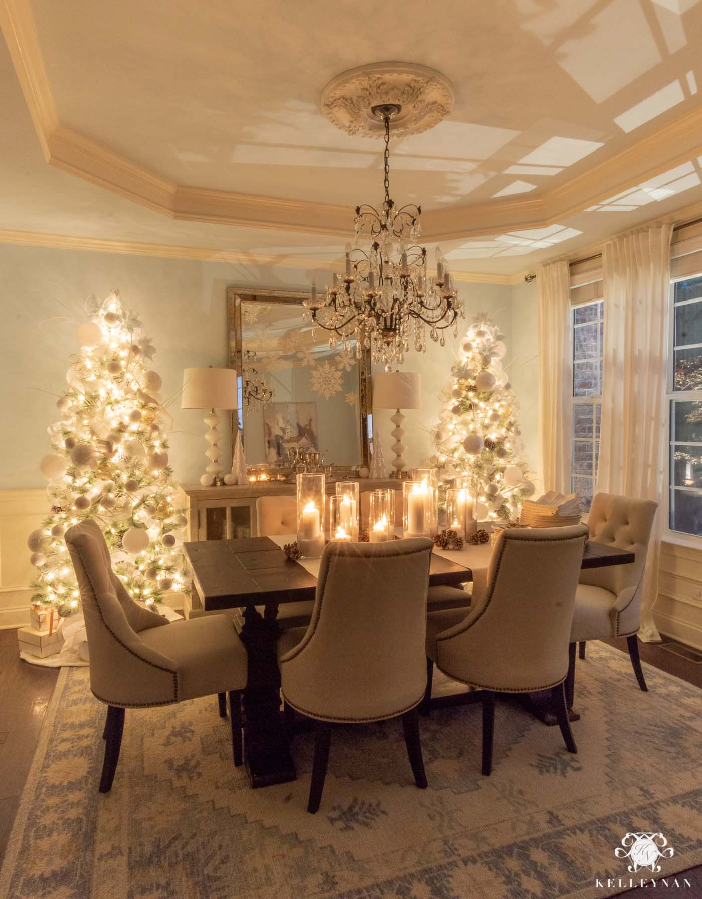 Cozy Christmas Decor -- Matching Flocked Christmas trees and Candlelight in the Dining Room