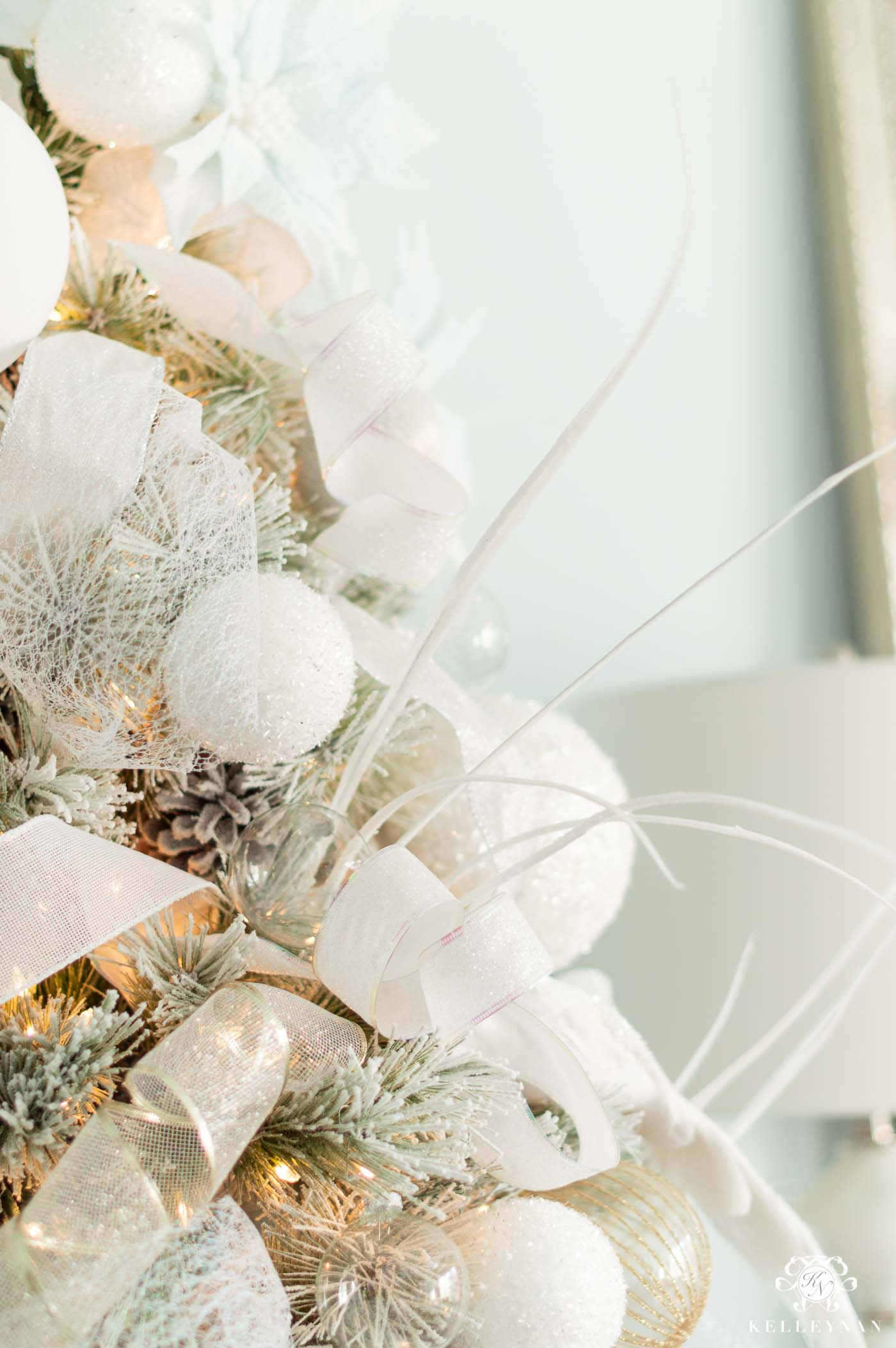 White Ornaments on Flocked, White Christmas Trees with Pale Blue Accents