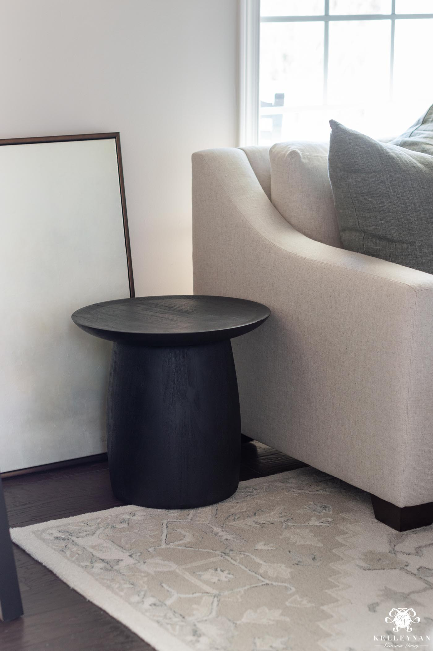 Black drum table as side table in the conversation room
