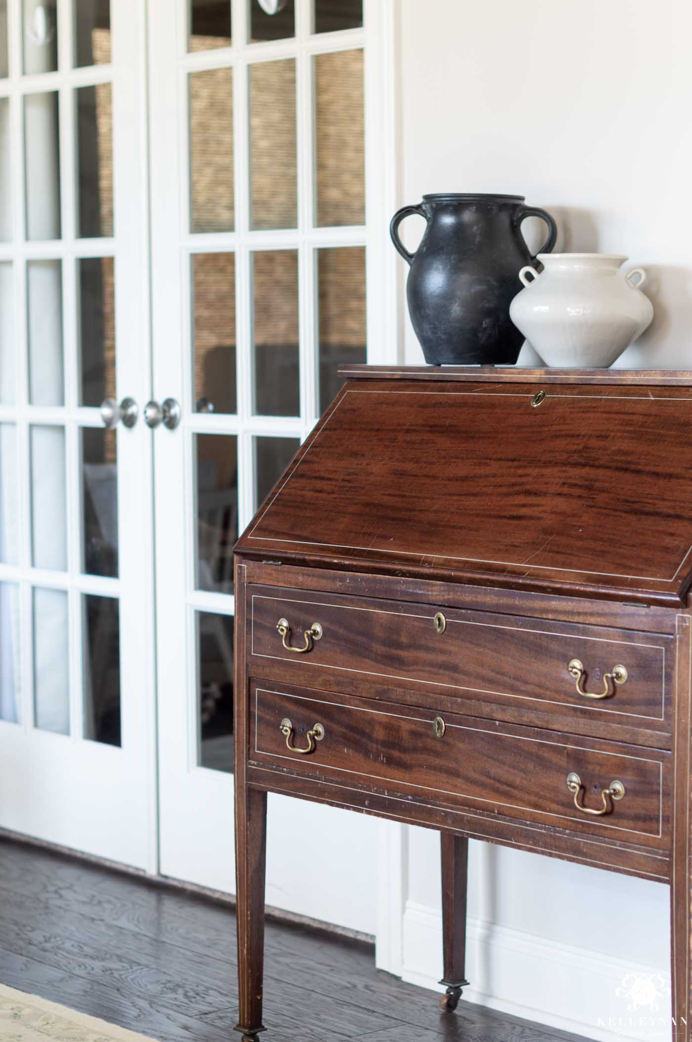 antique secretary desk in an otherwise transitional conversation room