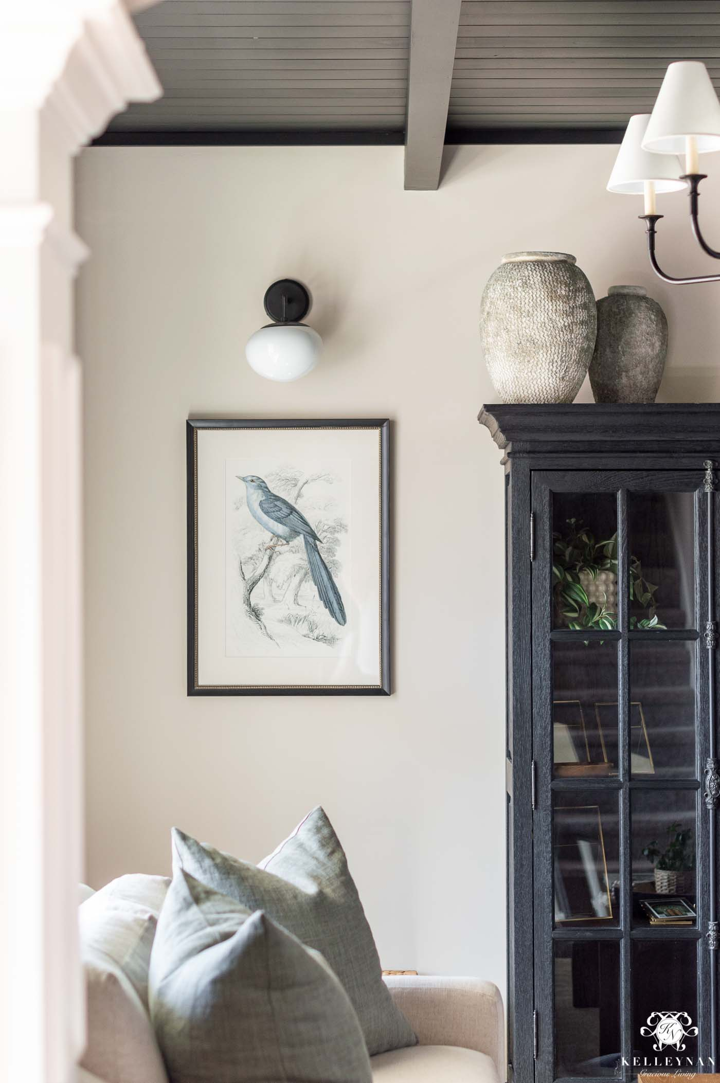 living room ideas and inspiration with sconces and a black statement feature ceiling