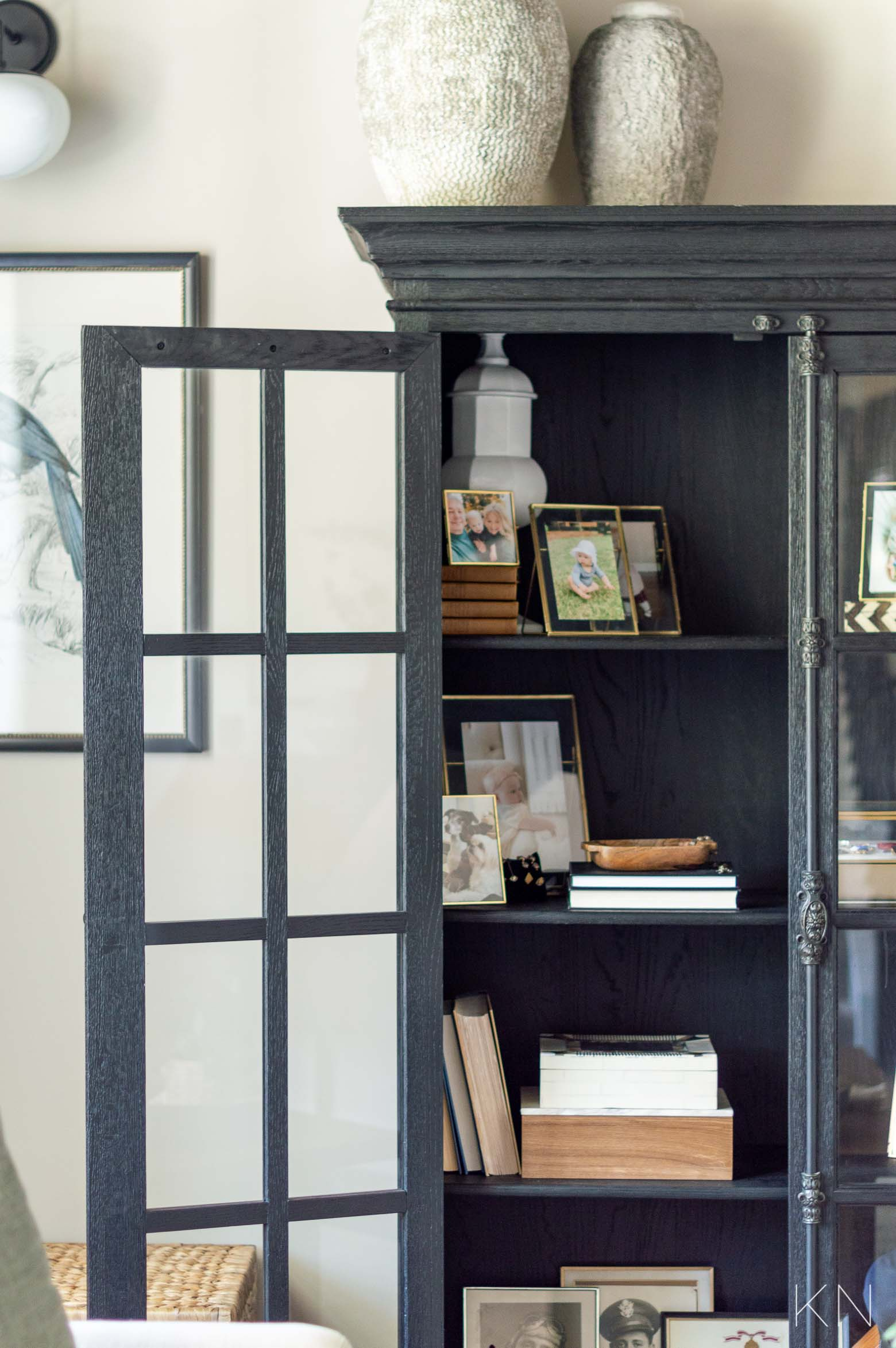 Styling and Decorating the Inside Shelves of a Living Room Cabinet