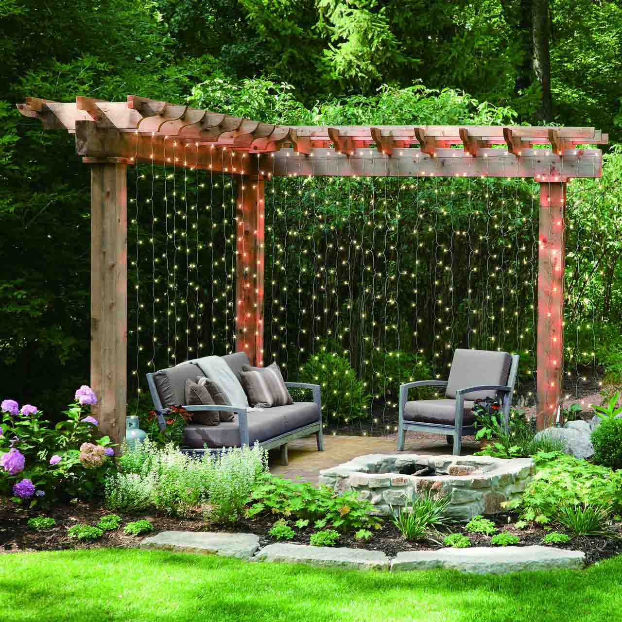 Amazing Outdoor Decor -- Affordable Wall of Curtain Twinkle Lights