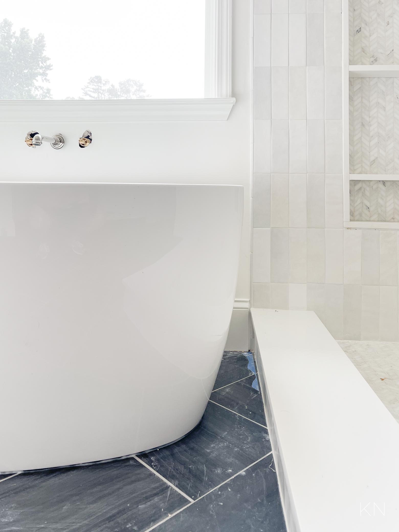 freestanding tub beside shower setup