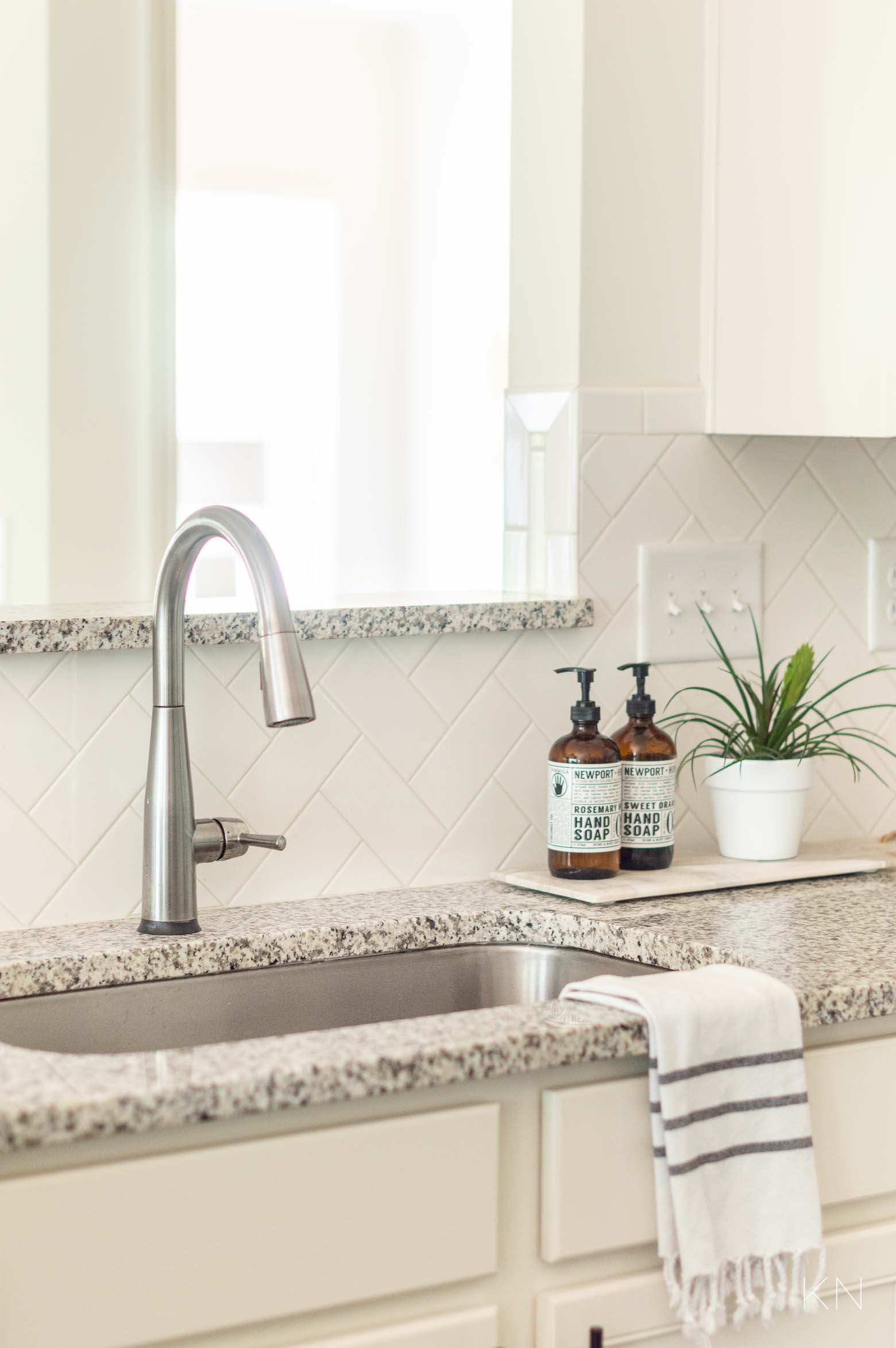 Updated Kitchen Faucet and Other Ways to Update a Builder Grade Kitchen
