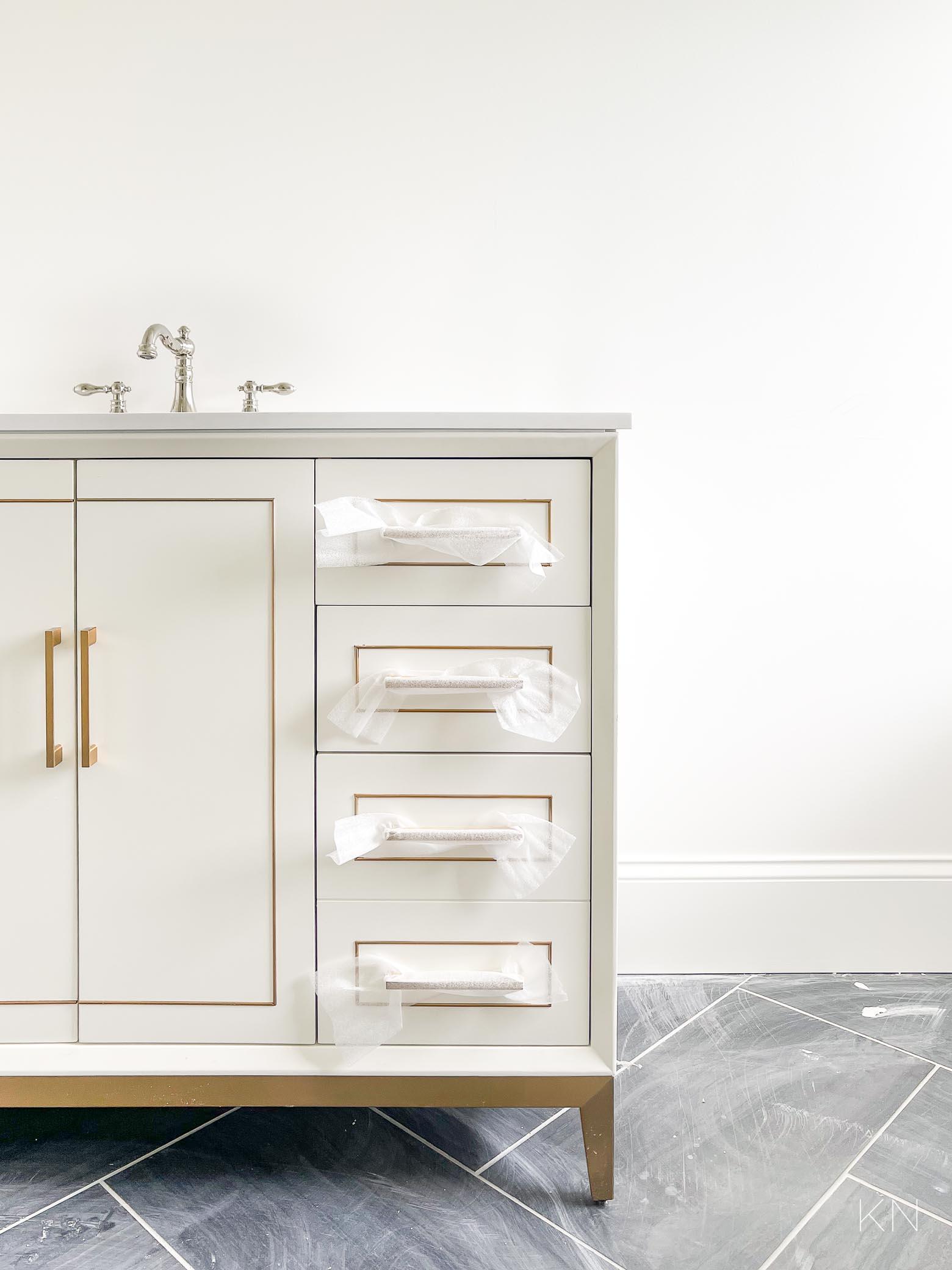 master bathroom progress -- the white and brass vanities
