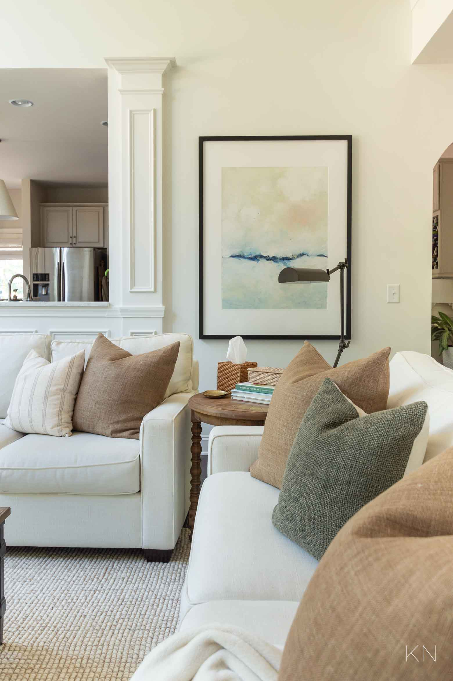 White Living Room with Brown and Green Pillows for Fall Decorating