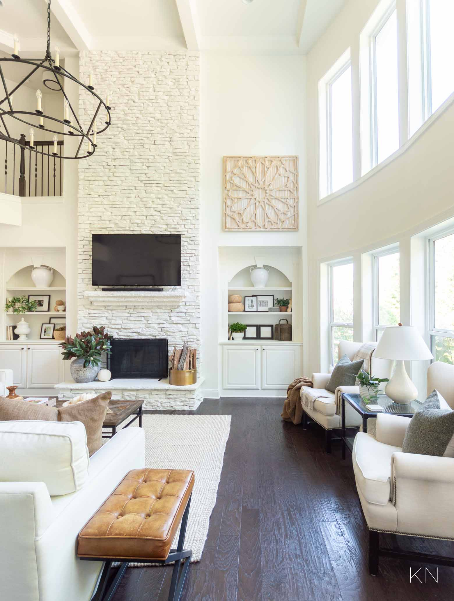 White Living Room Design with Statement Two Story Painted Stone Fireplace